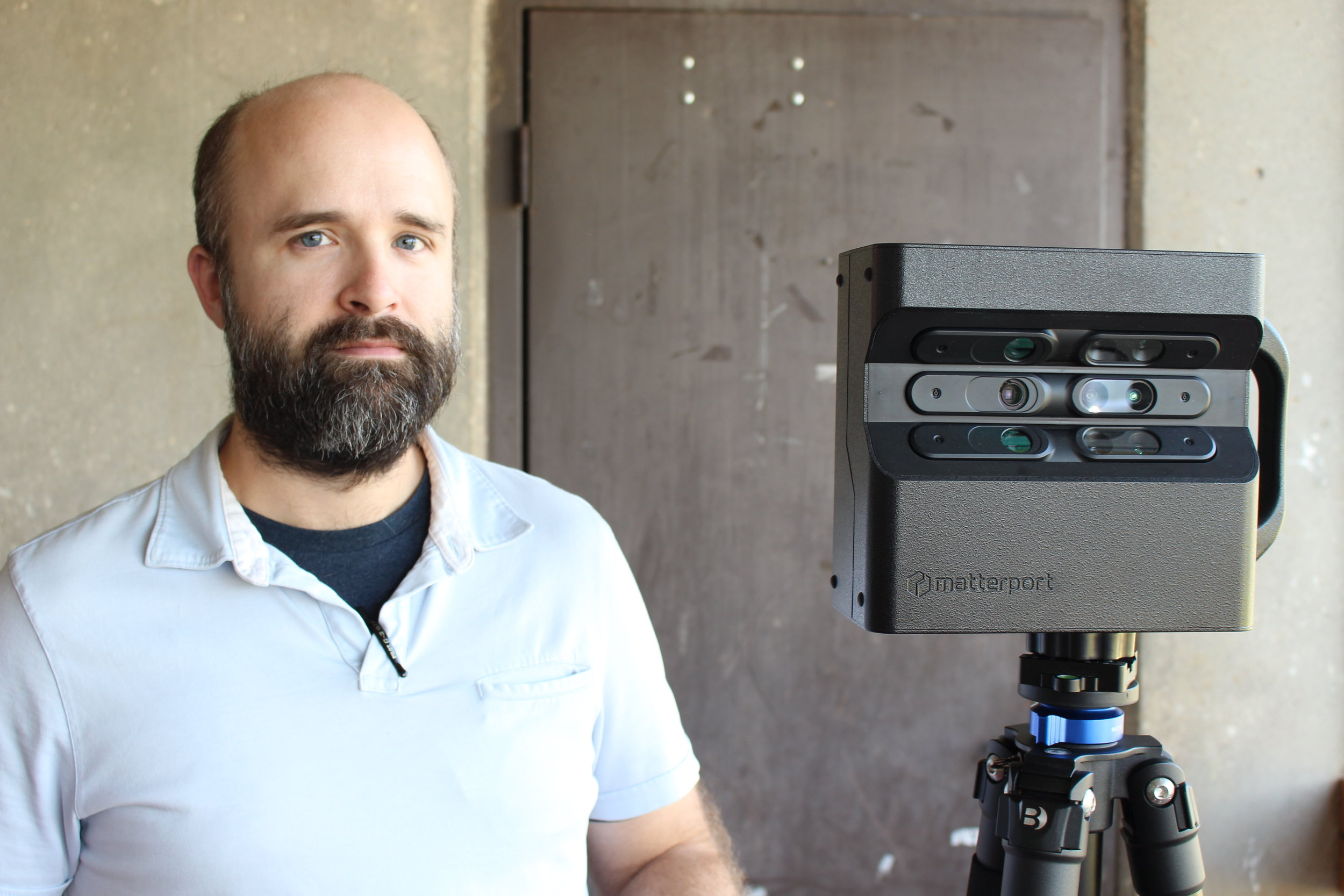 Andrew Brister with his Matterport camera. The images captured on this device create the model seen below.