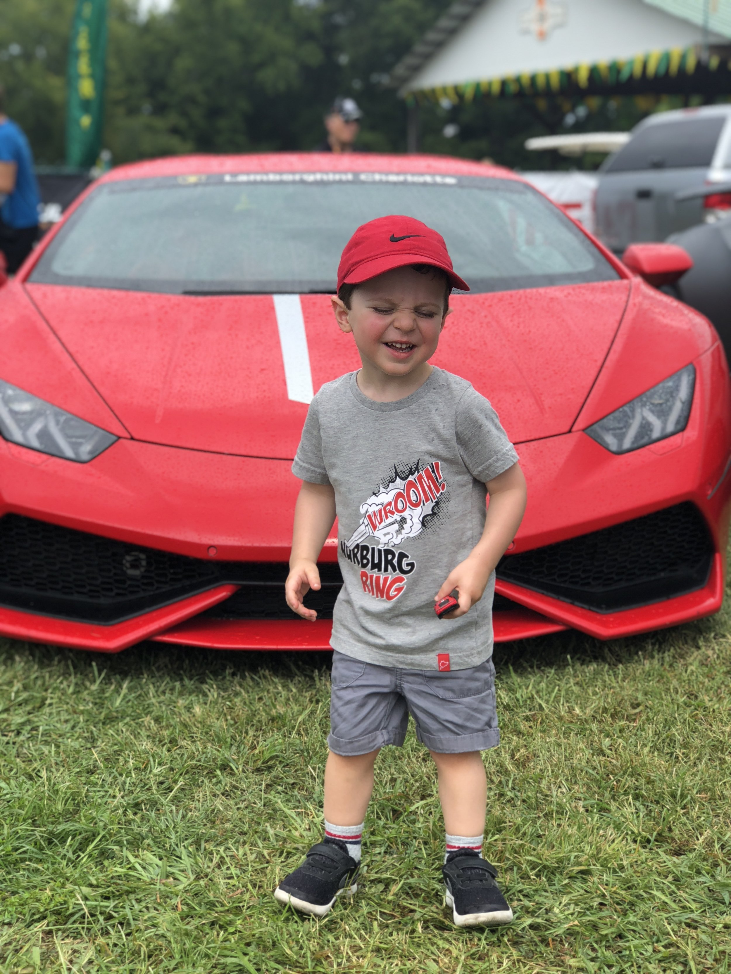 Toddler with Lamborghini at VIR IMSA Series