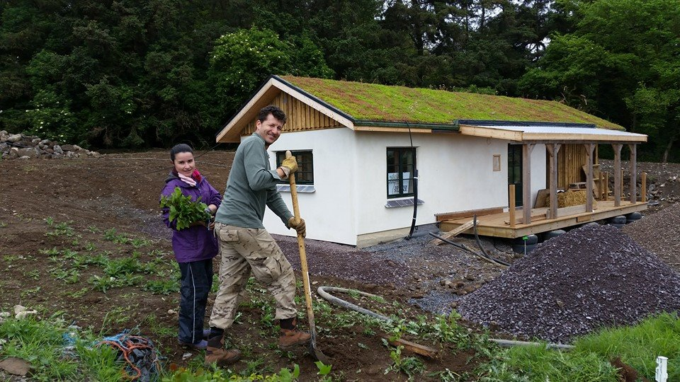 The straw bale built farm office nearing completion.