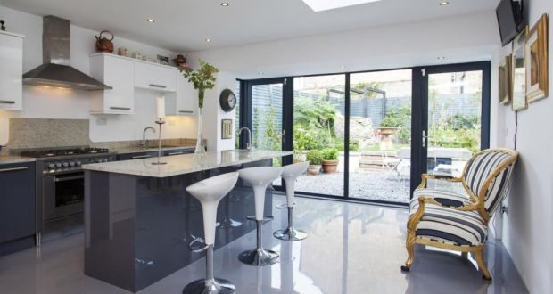 The new kitchen extension opening to the landscaped garden.