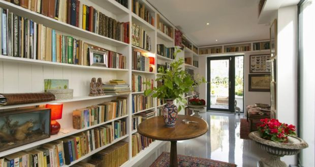 The secluded library room opening to the garden & its side courtyard