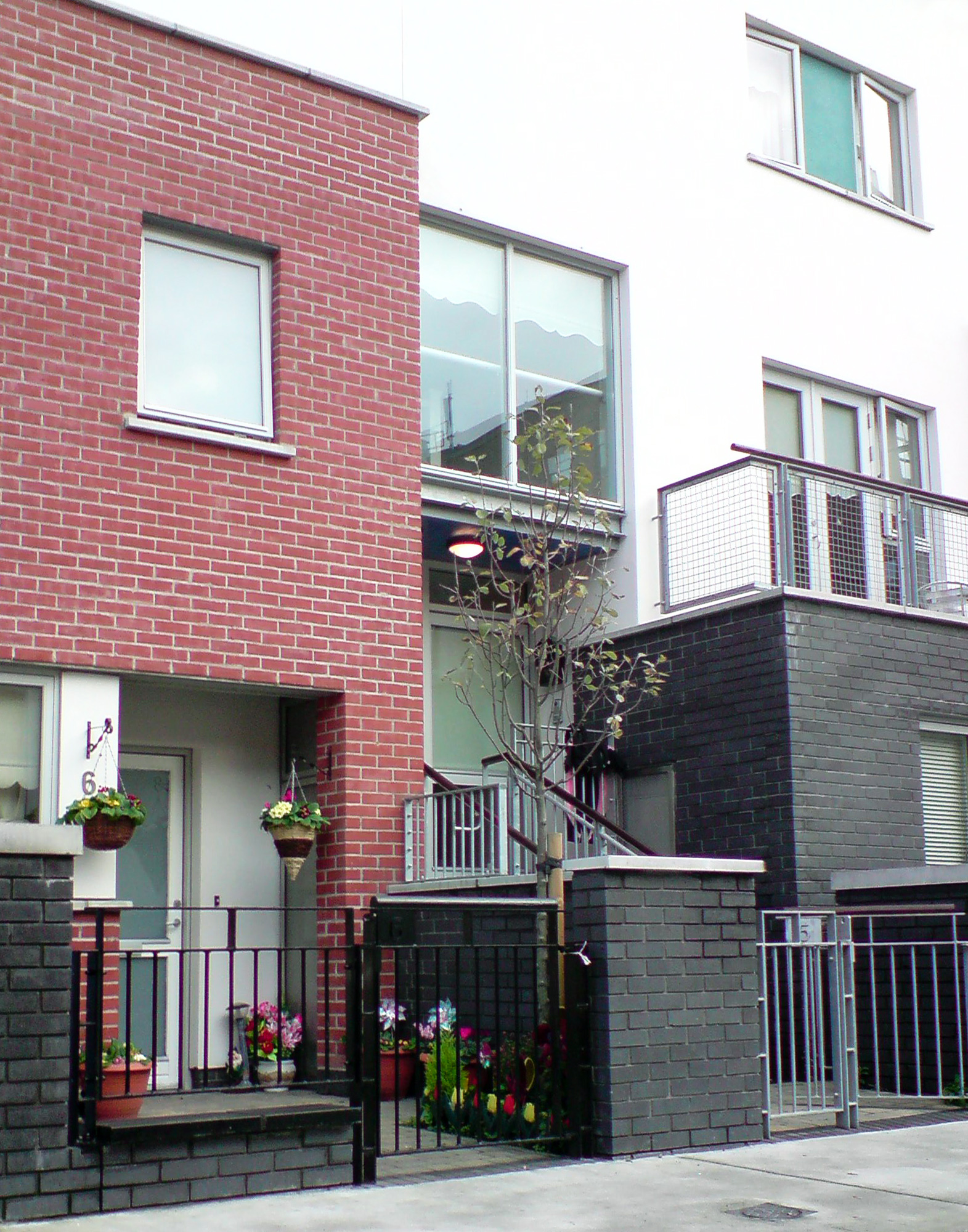 Infill_Housing_Planting_Residents.JPG
