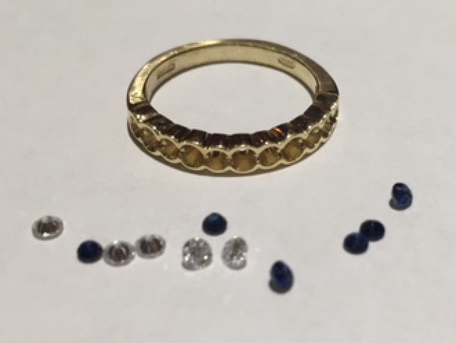 Beverleys eternity ring with unset diamonds and her original blue sapphires