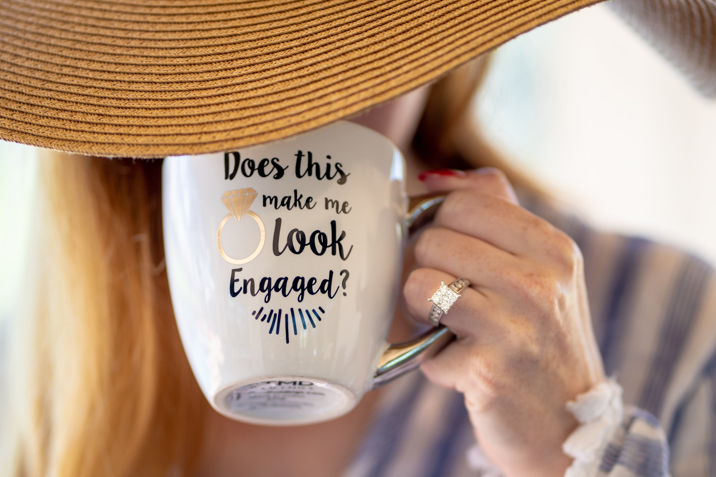 "Mug that says ""does this make me look engaged"" with engagement ring - Photo by  Jose Martinez  on  Unsplash"