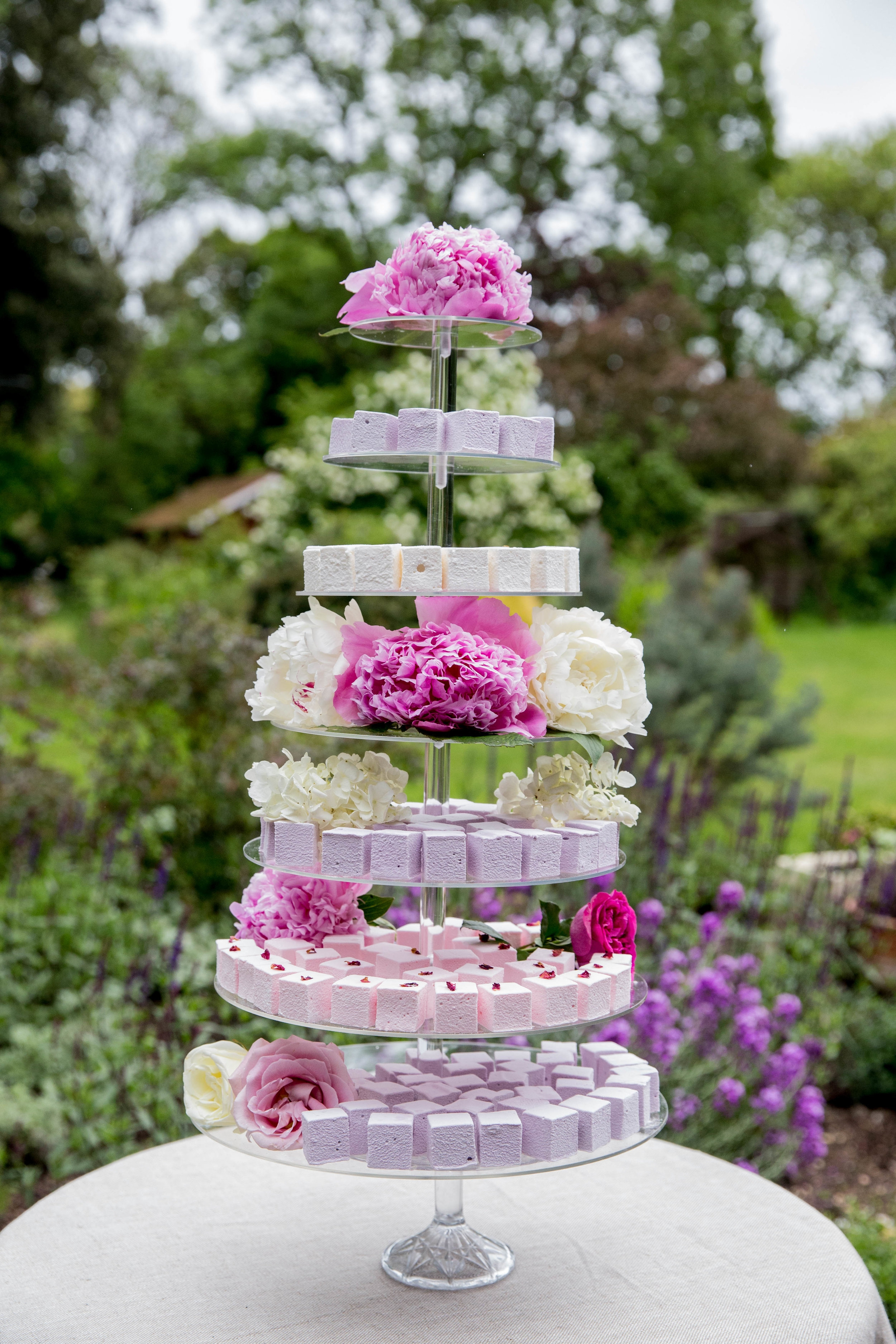 7-Tier Marshmallow Tower crammed with 300 marshmallows. Ask your florist to supply additional flowers to co-ordinate the wedding flowers with the marshmallows