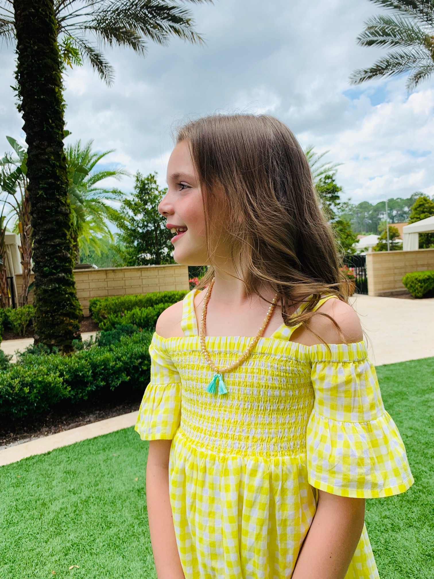 e0f3ad31ecfa9 This little yellow dress is one of Lily's favorites this season. How sweet  is it paired with this adorable little girl's necklace by Joy and Light  Designs?