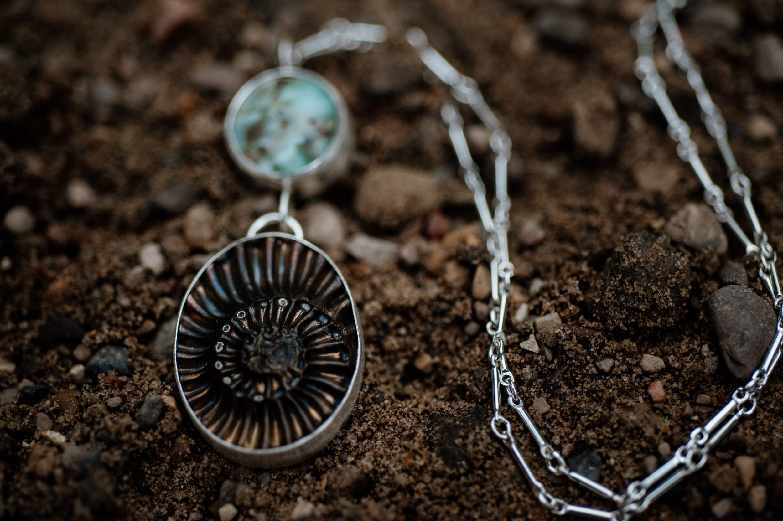 pyritized ammonite negative + red river turquoise silver statement necklace photo by michelle craig photography