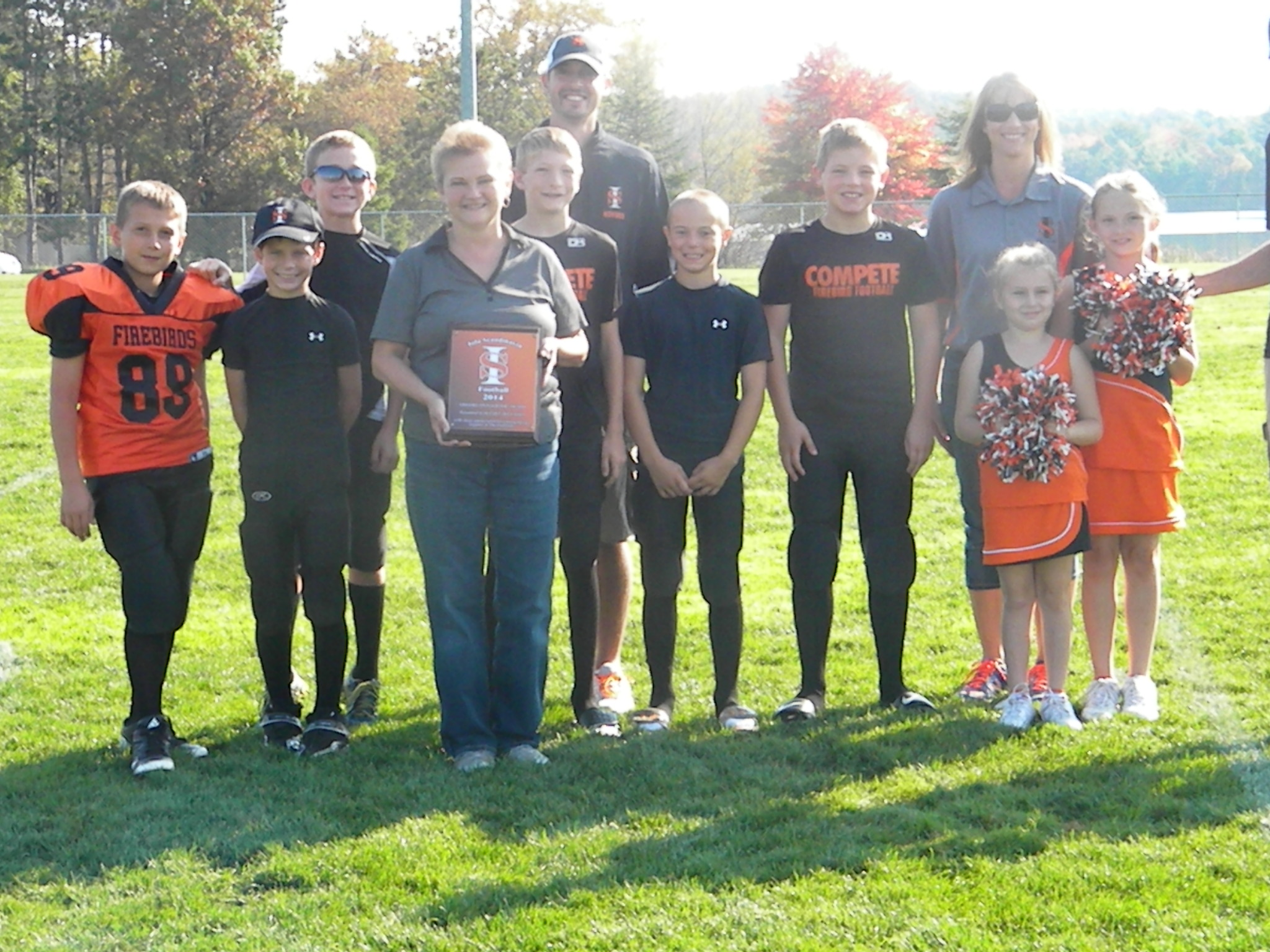 Sheri Kielblock of Silver Lake Lanes is presented with a plaque for hersupport ofthe Firebirds program.
