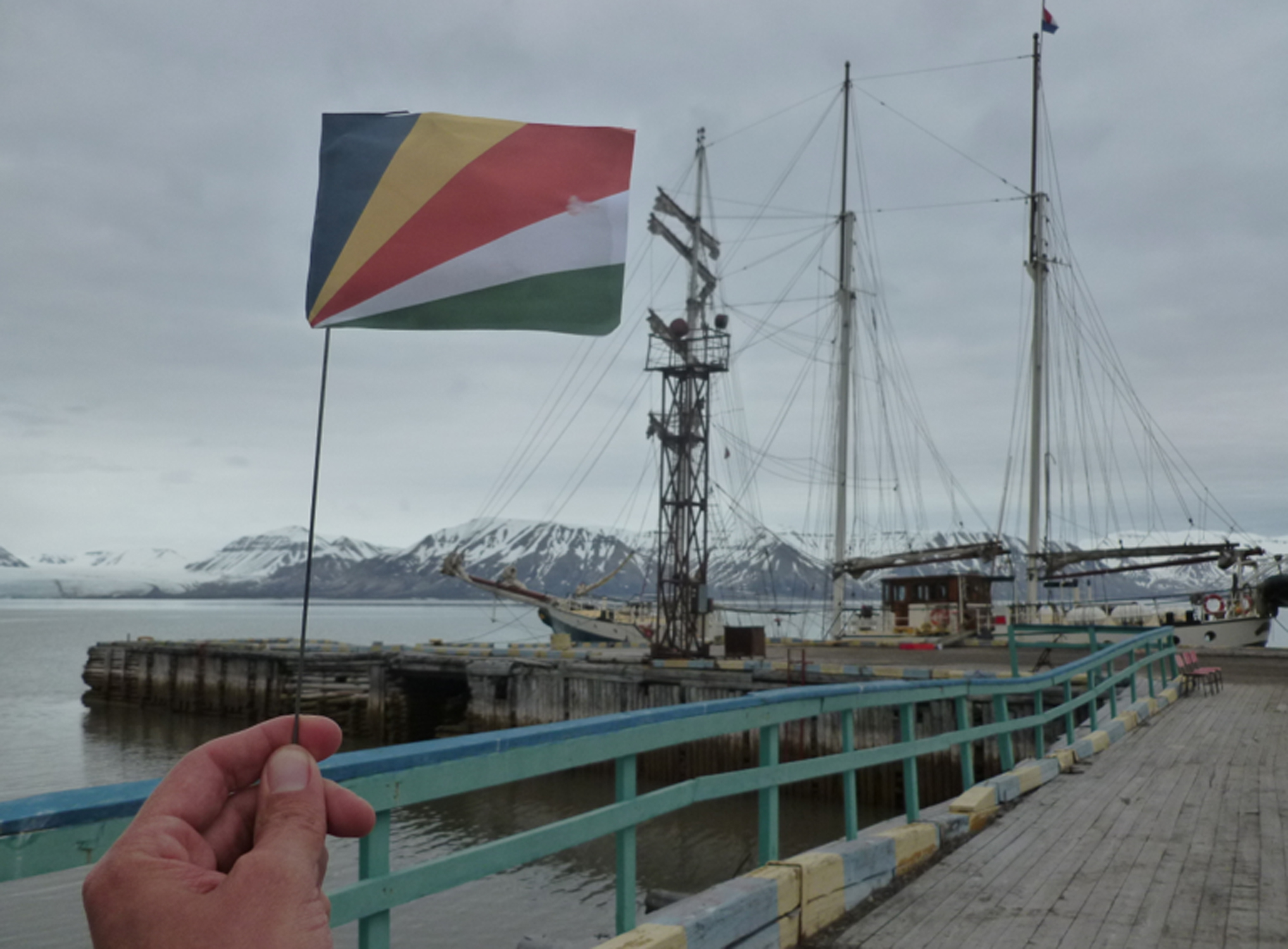 Mike Iacovone holds up the flag of the Seychelles in the Arctic Circle on the Seychelles' independence day (June 29).