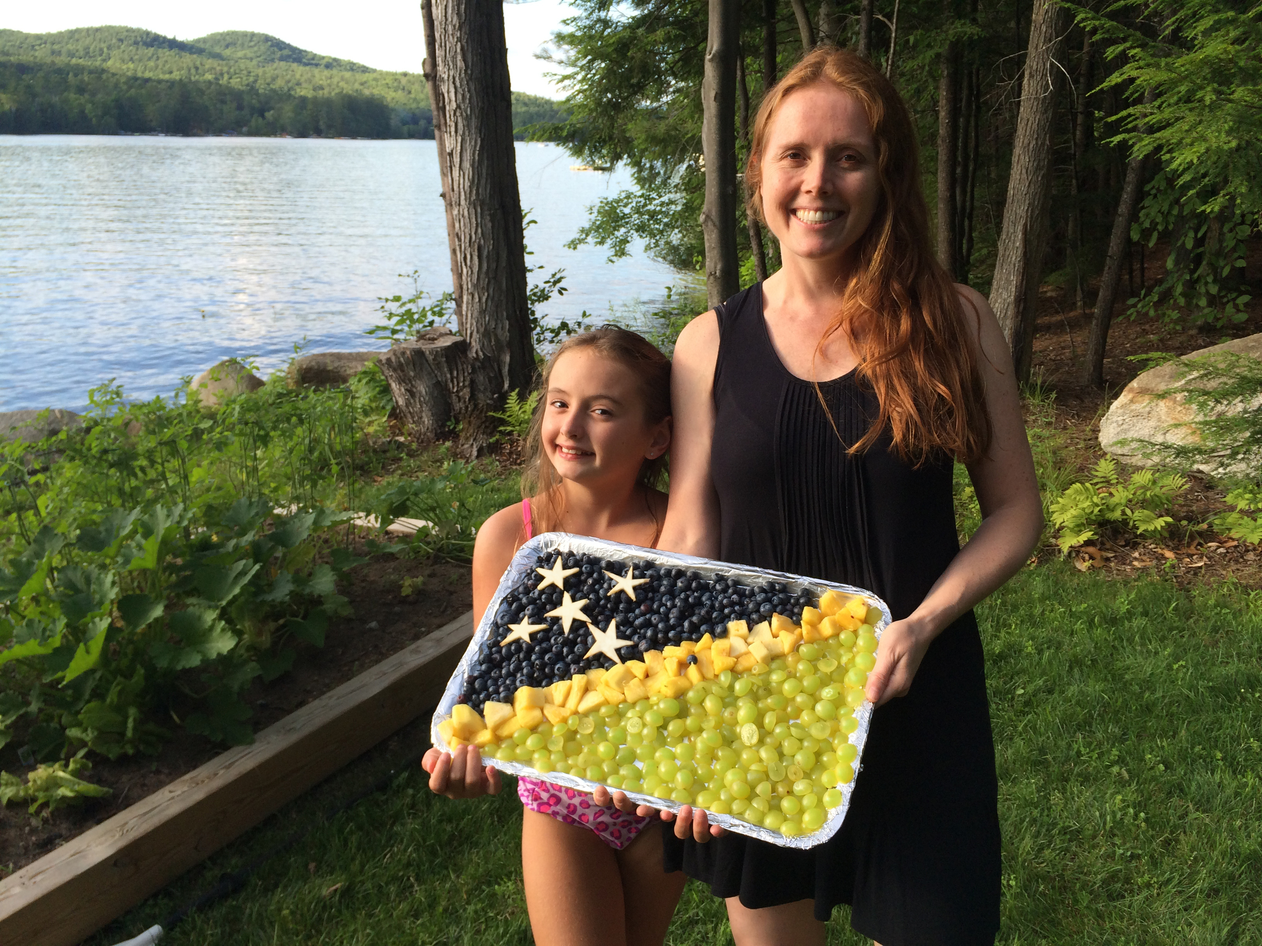 Amber and Heather create a flag out of fruit for the people of the Solomon Islands on their independence day (July 7).