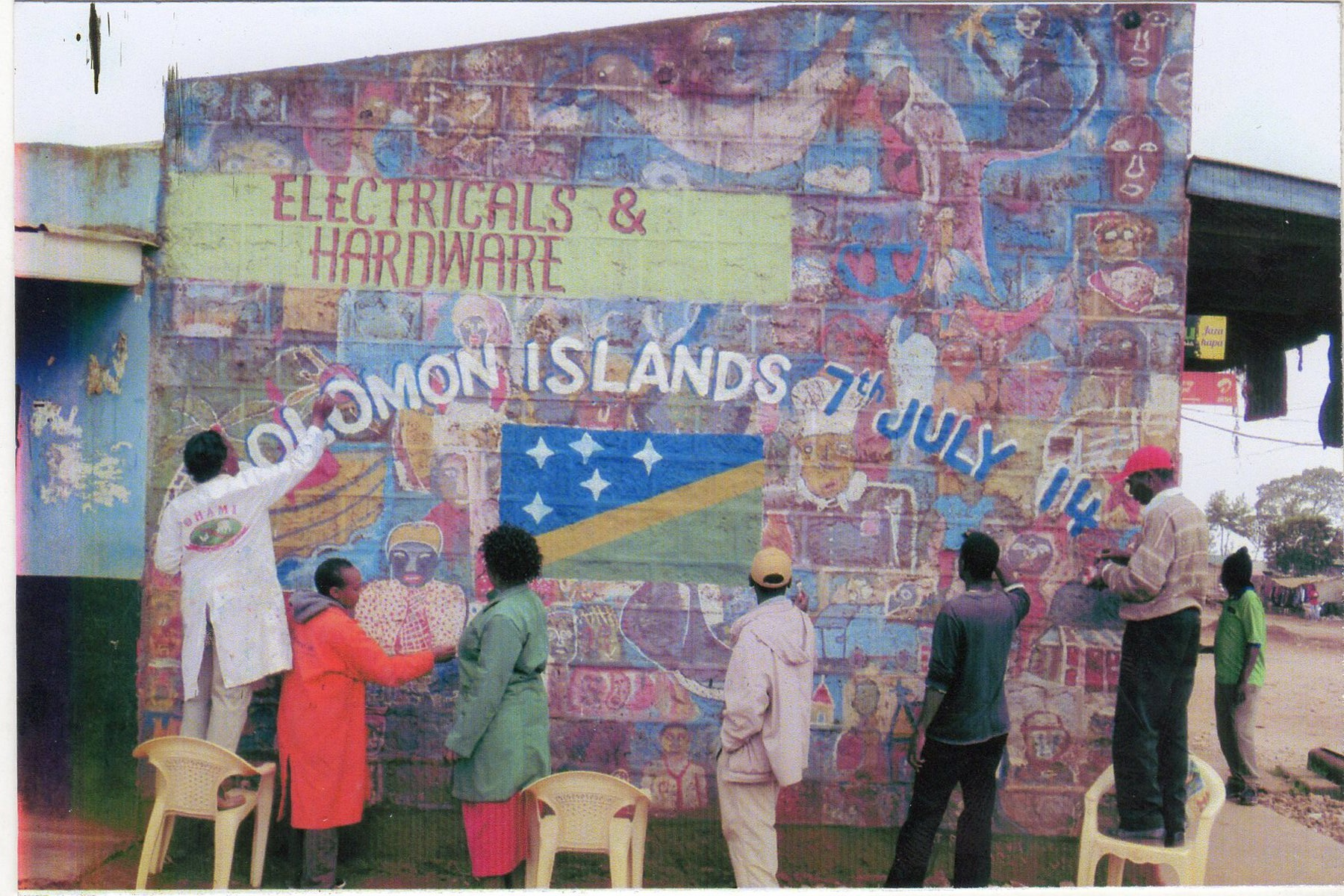 The Ngecha Artist Association in Kenya creates a mural for the people of the Solomon Islands on their independence day (July 7).