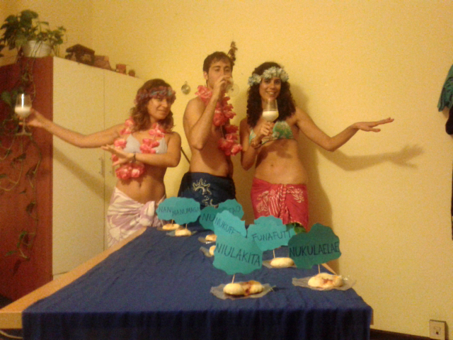 In Italy, Elisabetta, Alice, and friends cook pizzas in the shape of the Tuvalu Islands on Tuvalu's independence day.