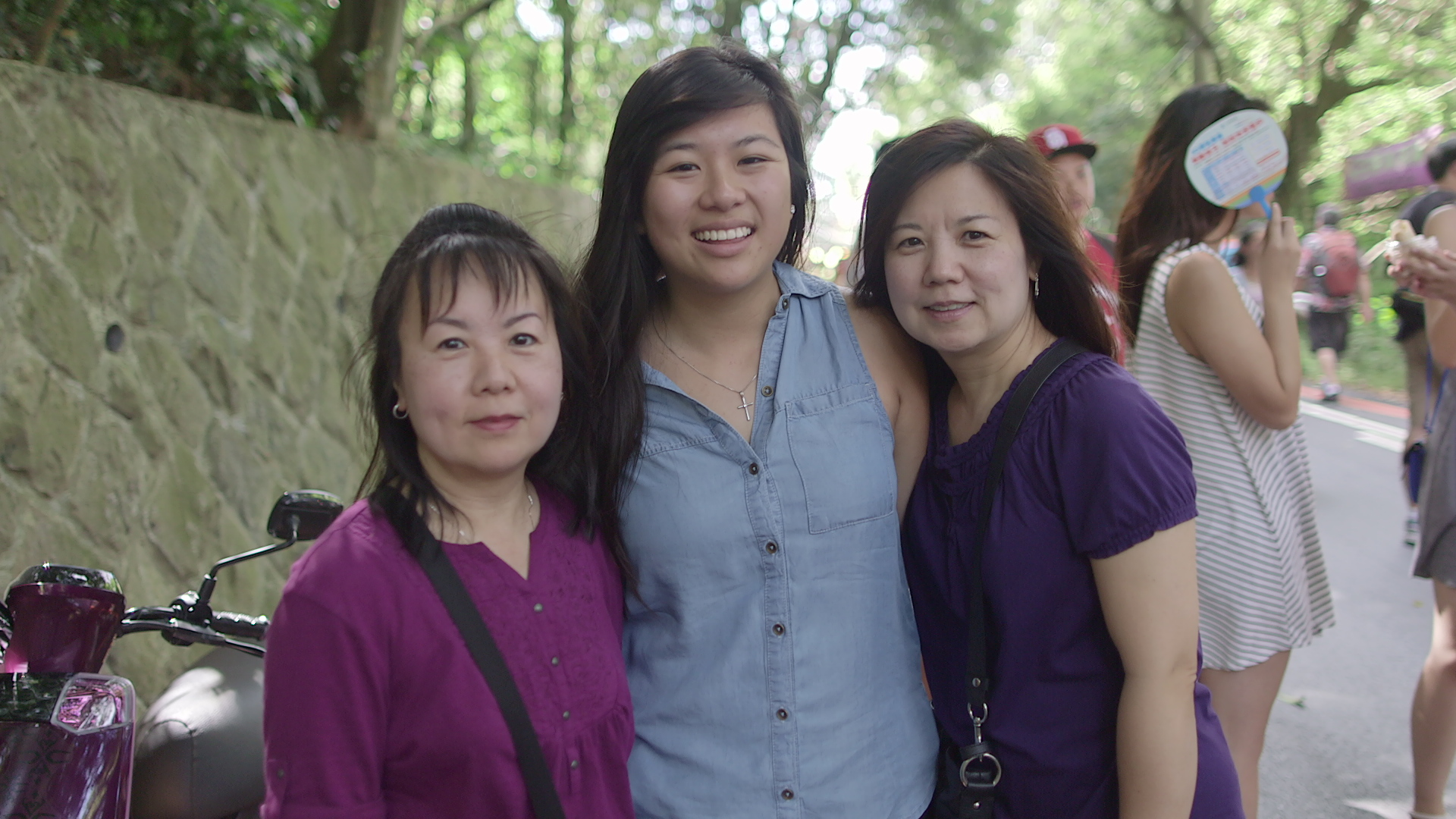 Josephine, Auntie Yann, and Auntie Julie share a beautiful moment together as they search through the MaoKong Outdoor Market.
