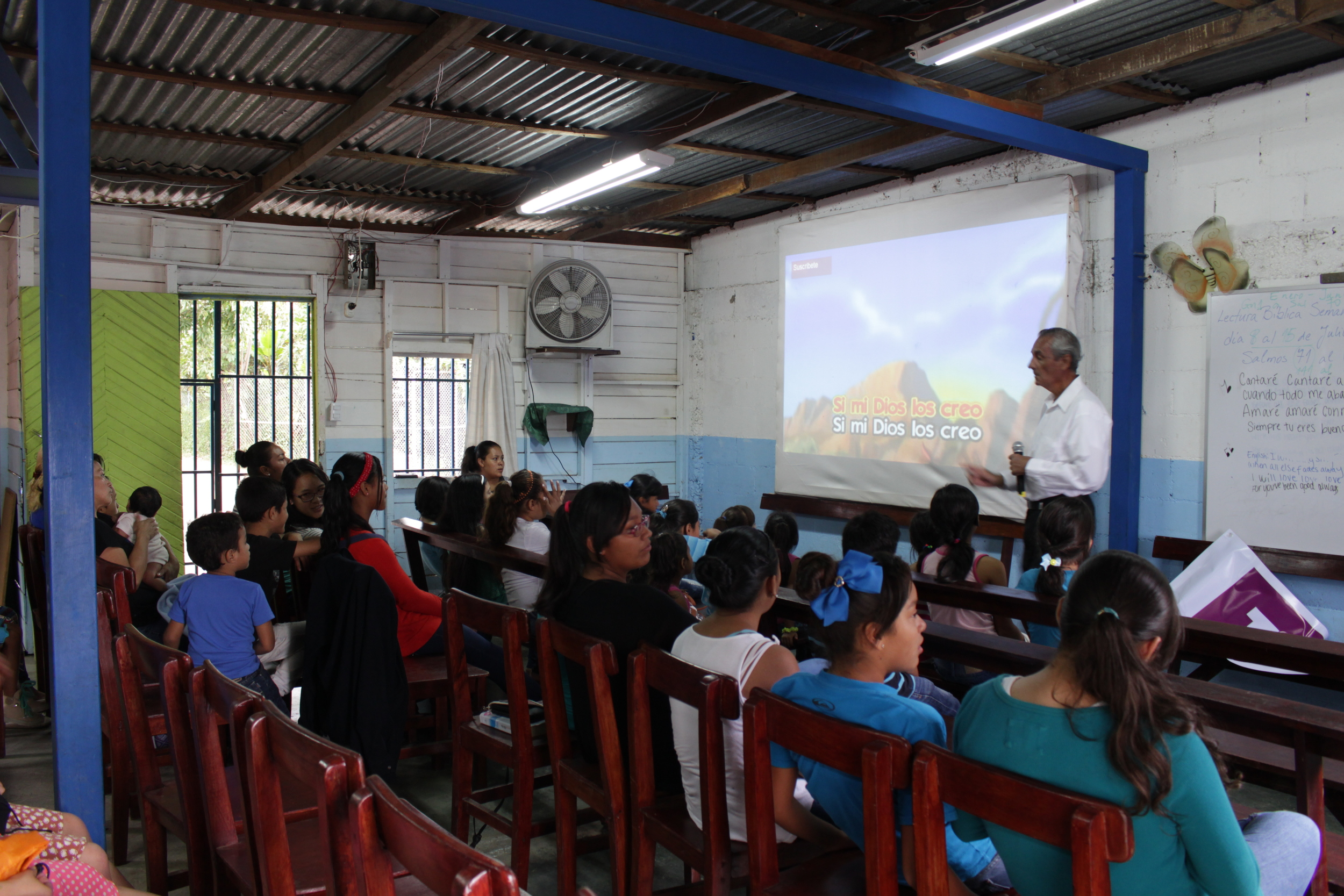 Pastor Horacio doing worship with the children and youth