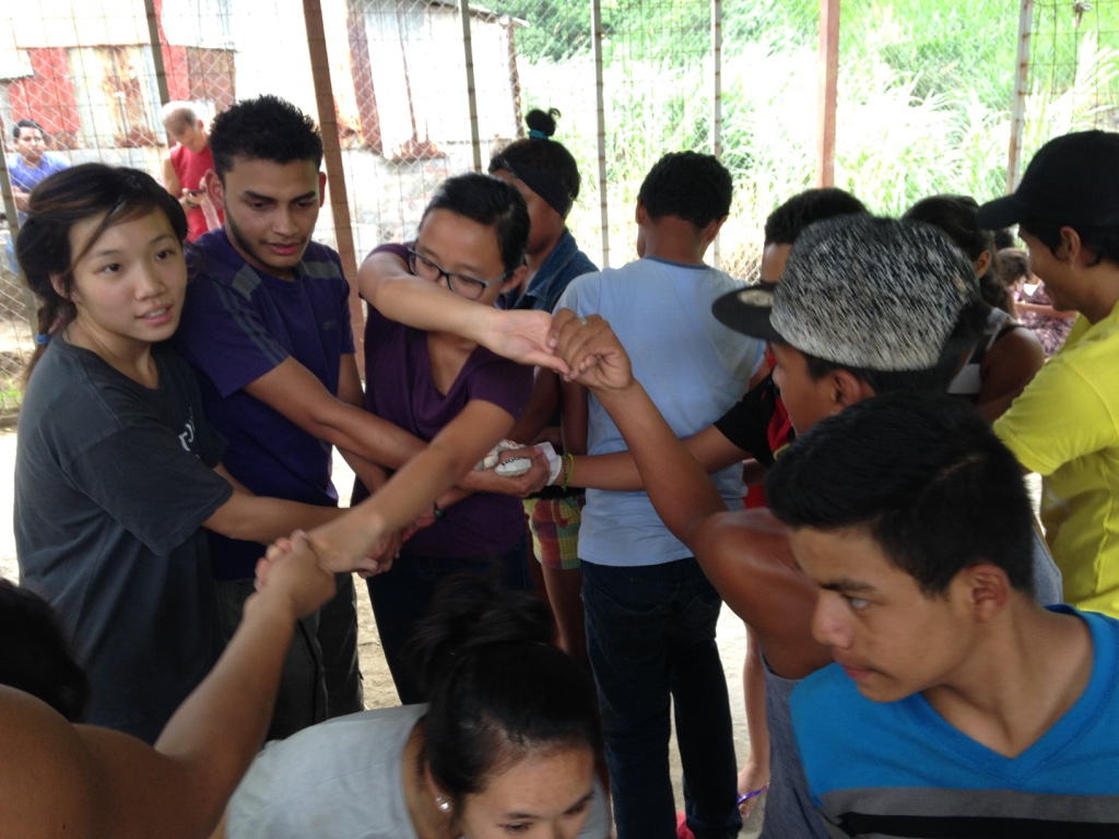 Playing a game with the La Carpio teenagers