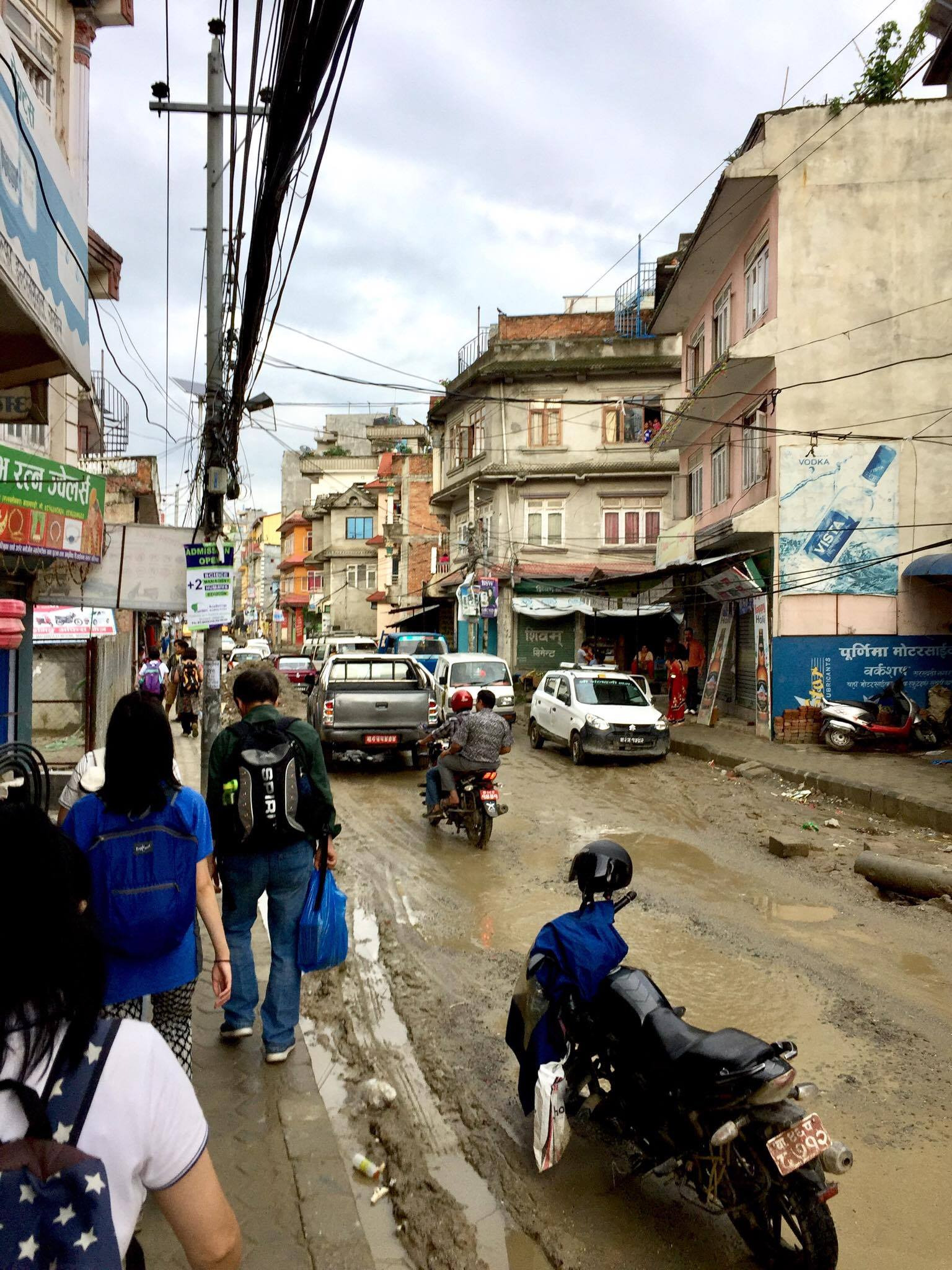 Our team would flyer and go shopping for groceries on these streets. Notice the dirt roads and the big potholes. Sometimes there were no sidewalks and it makes it difficult.