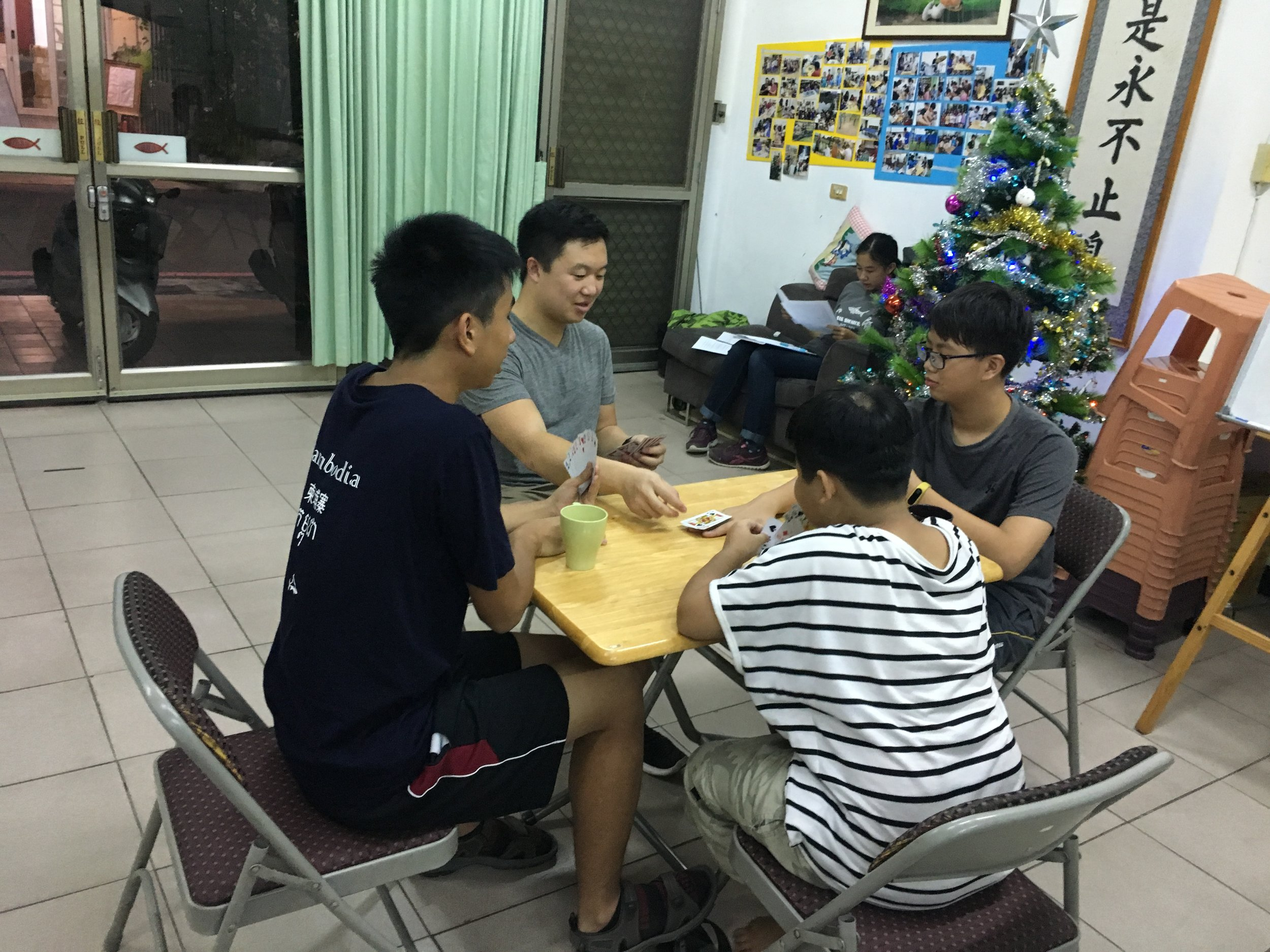 Playing games with kids who attend the community center