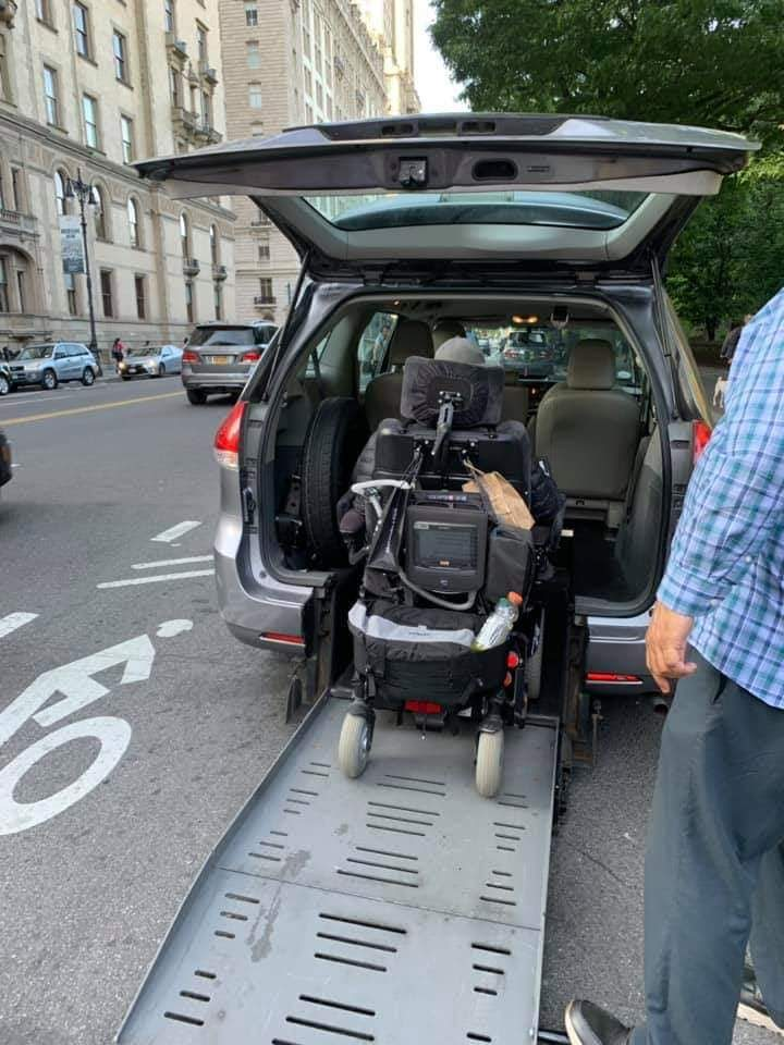 Our client Kristofer is getting into a wheelchair accessible vehicle in New York City.