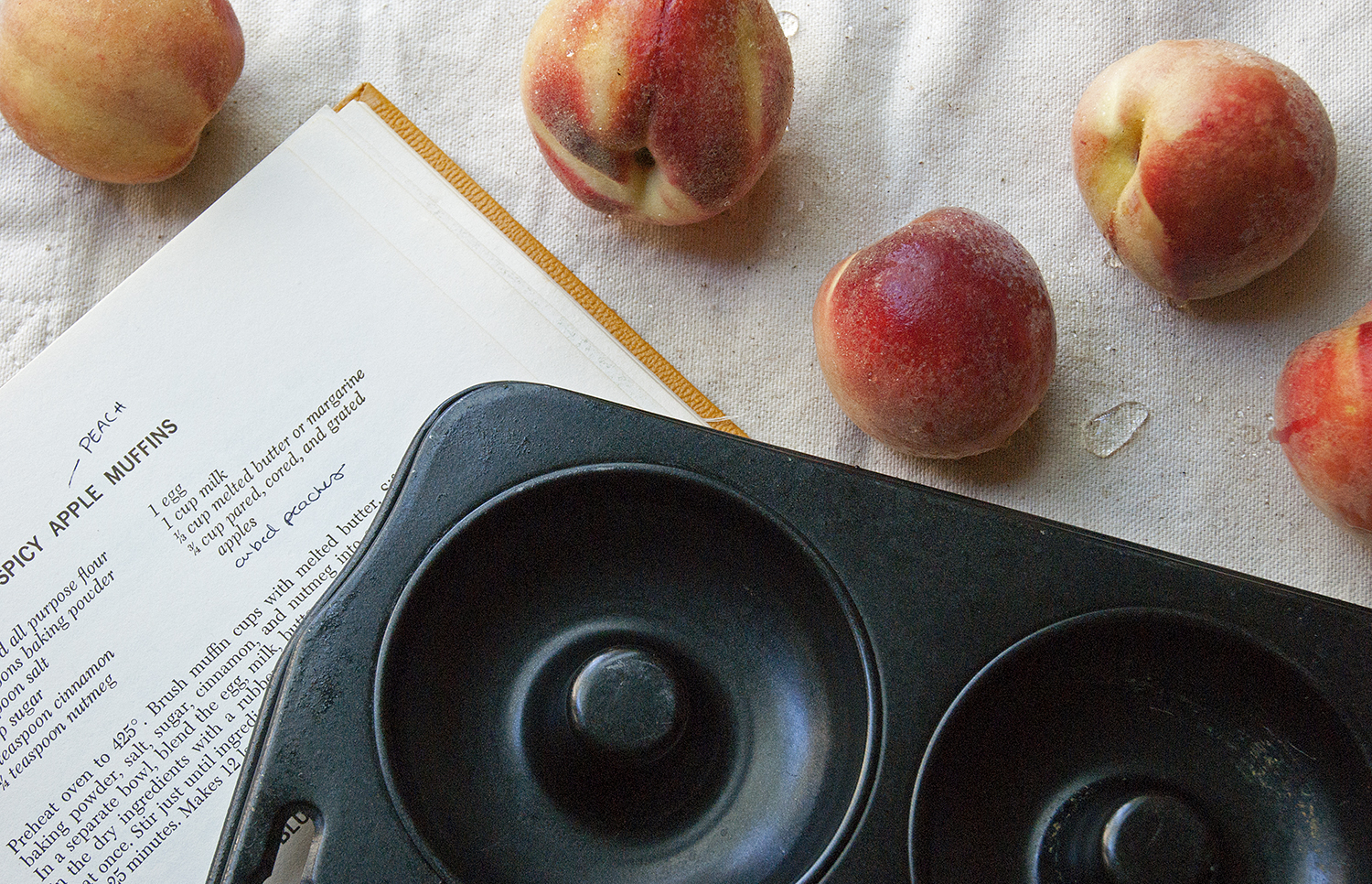 peaches + cookbook + pan.jpg