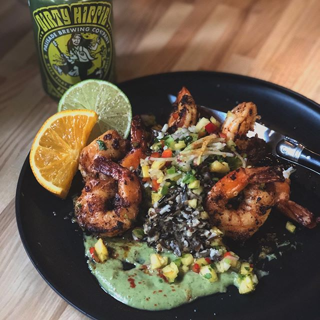 Weekend Special: Blackened Jumbo Shrimp over Toasted Coconut Wild Rice/Quinoa Blend with a Avocado Cilantro Sauce and Jalepeno Pineapple Salsa . Served with a Dirty Hippie Wheat from @palisadebrewingco . #shrimpandwildrice #happyweekend #summereats #blackenedshrimp #keepitsimple #dirtyhippiewheat #begoodlivesimpleeatwell