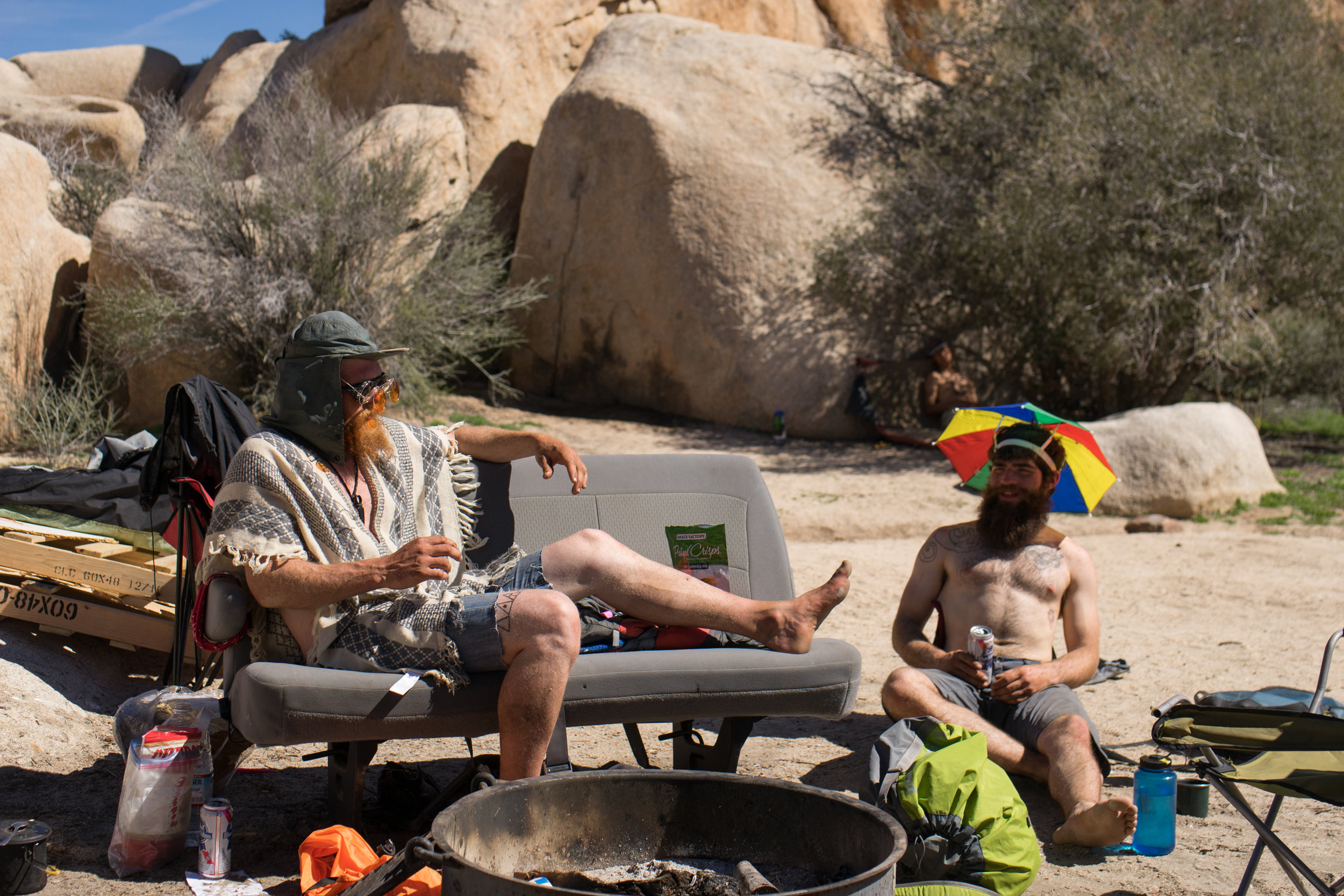 Two climbers at Camp #5 discuss potential routes for the day. Hidden Valley Campground is the place for odd, eccentric, climbers from all walks of life to come and associate with others. They often come to Joshua Tree by themselves, as both these climbers did.