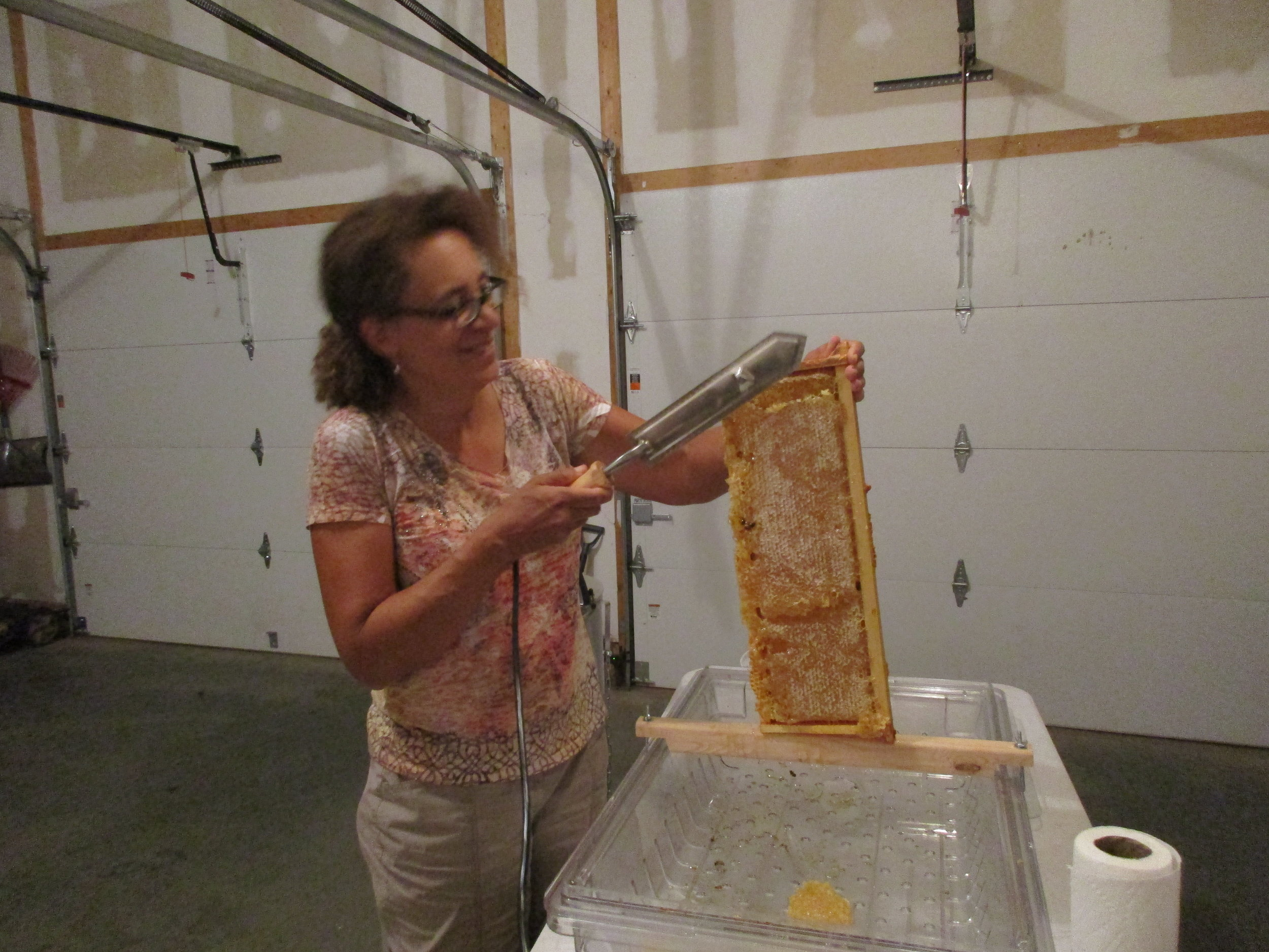 I get to do the first slicing off of wax cappings.