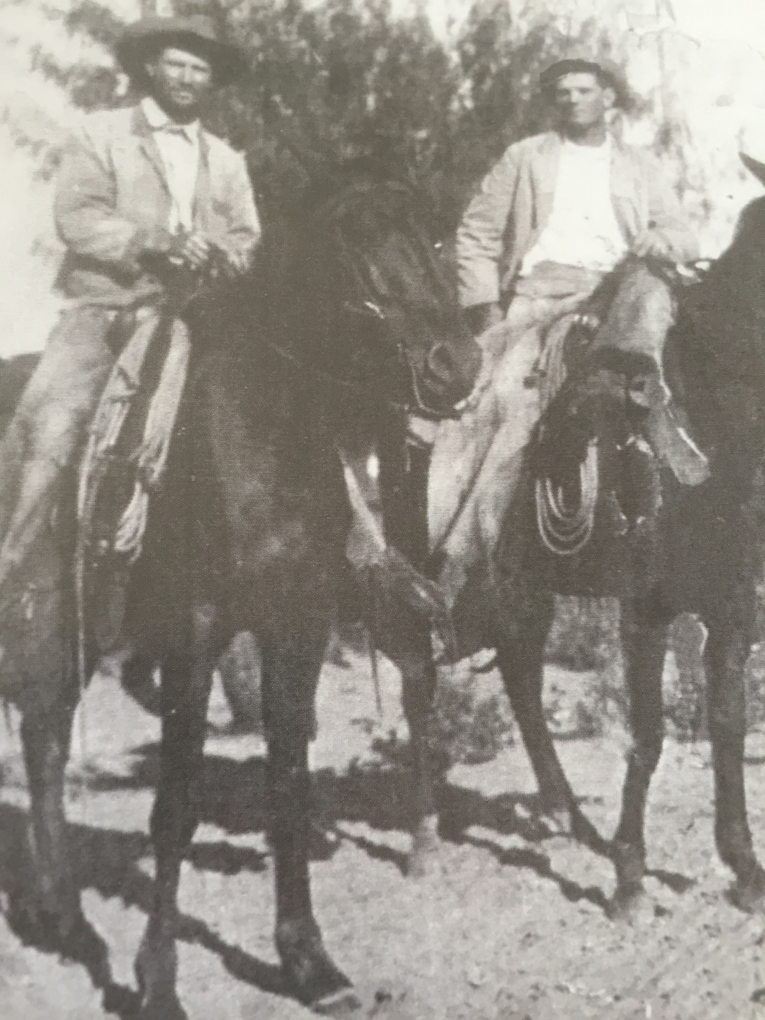 A.C. Jones, son of W.W. (Left) and Tom East after a raid on the East Ranch