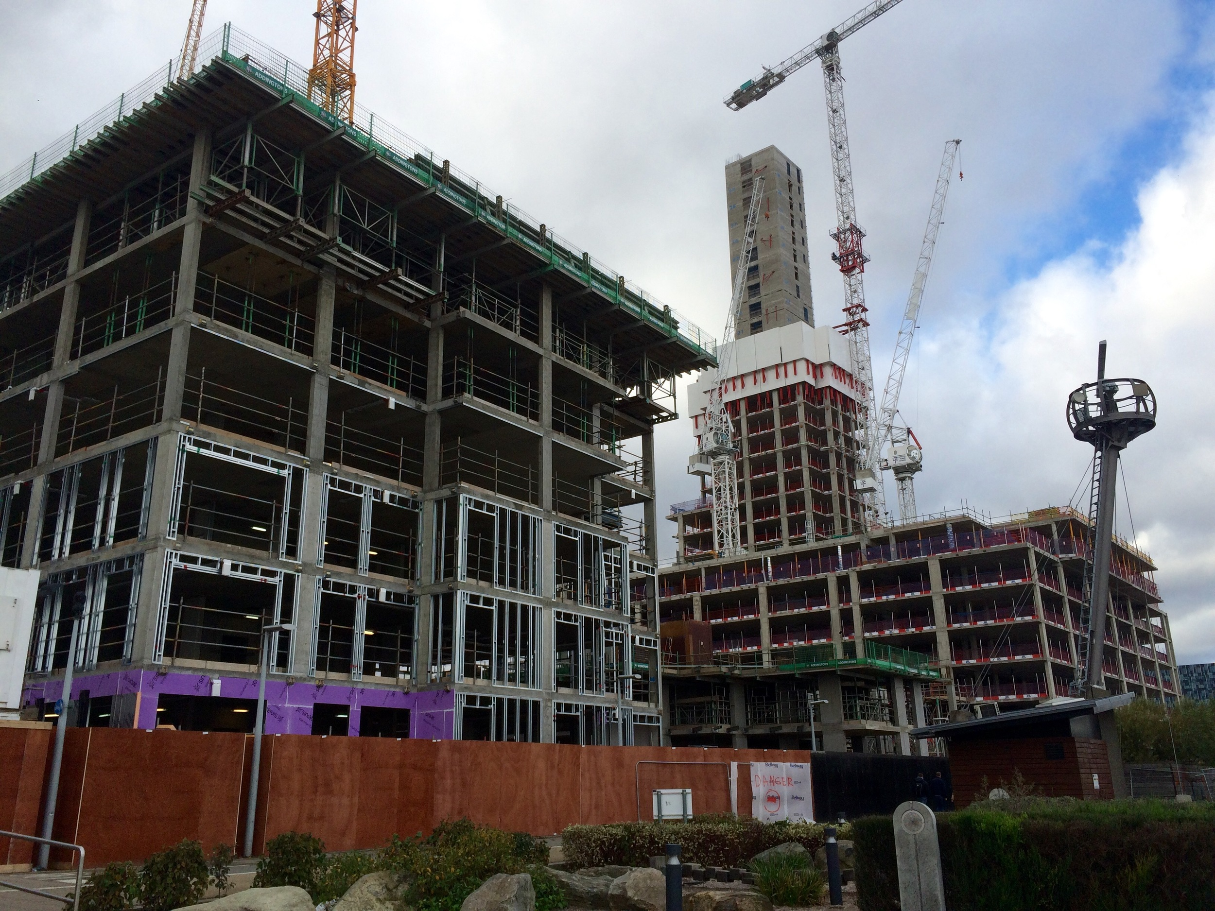 View northwest from Olympian Way - first few floors of the 23 storey Lighterman tower, between the associated affordable homes (left) and Waterman (right) -Nov 2015 [ greenpenlondon ]