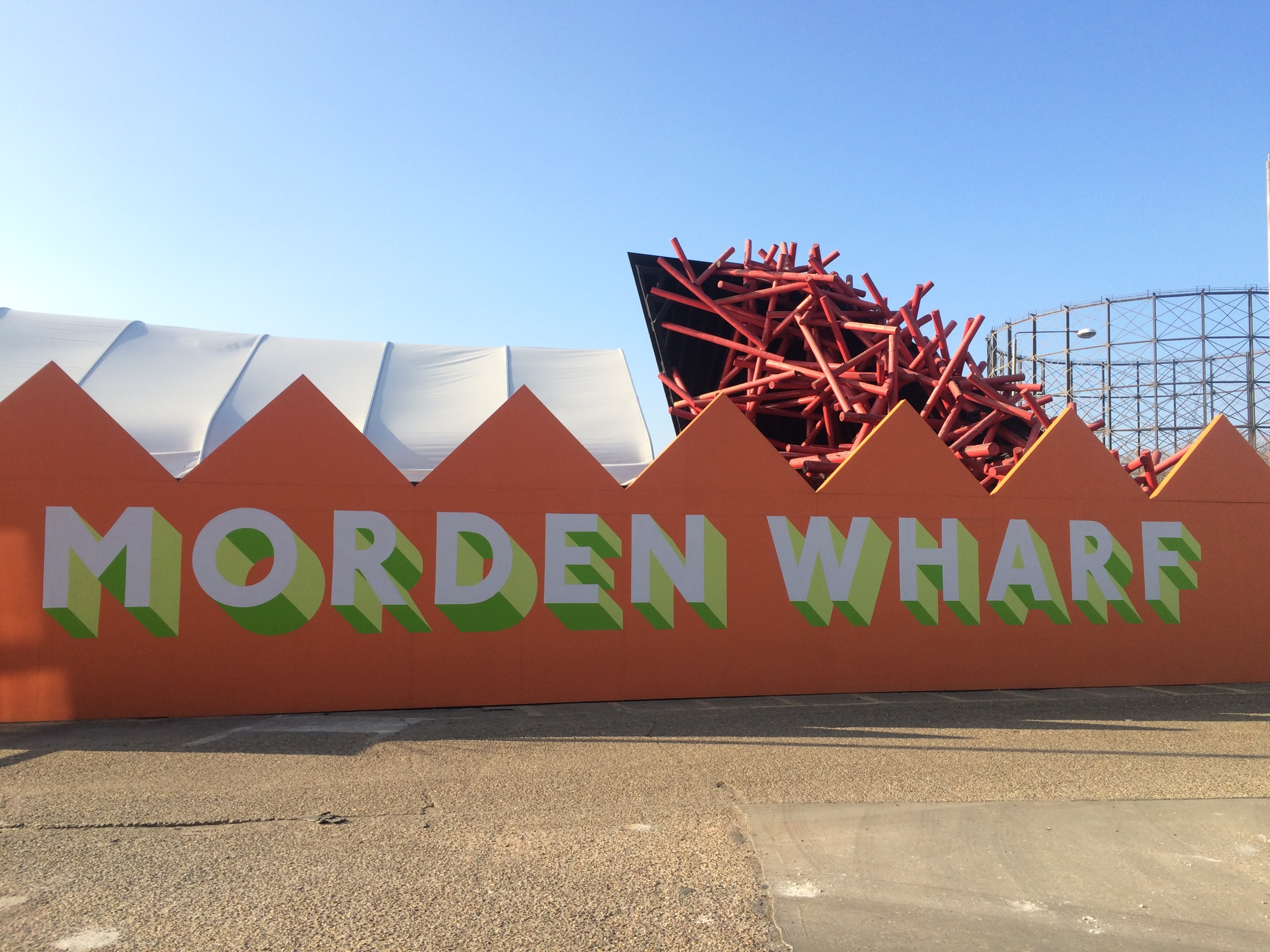 "Advertisement hoardings raised at the Morden Wharf site, seen here in front of the ""Giant Matchsticks"" structures which have been retained a piece of public art - March 2016 [ @greenpenlondon ]"