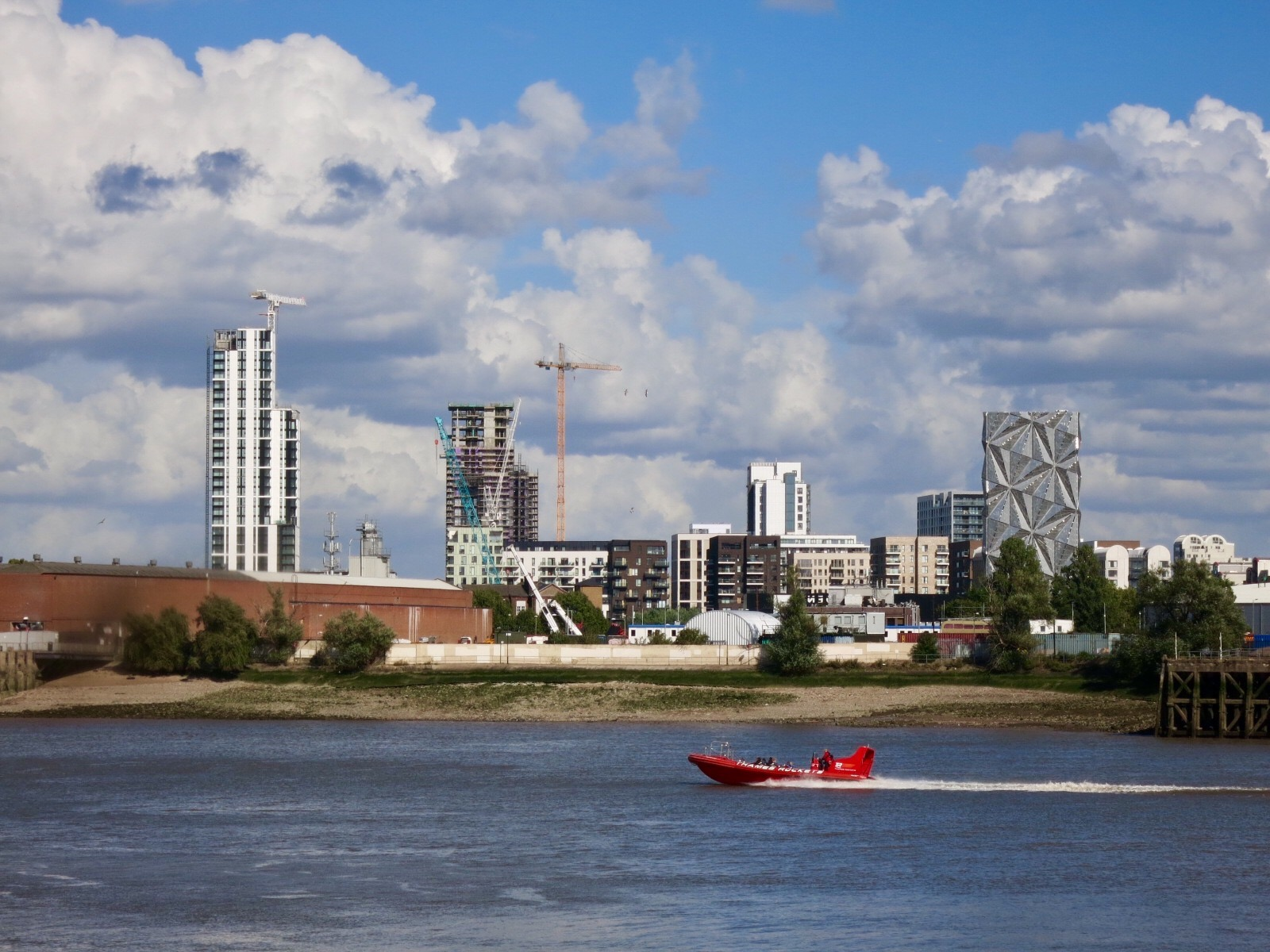 Greenwich Peninsula's Lower Riverside developments, including The Waterman and Lighterman towers.