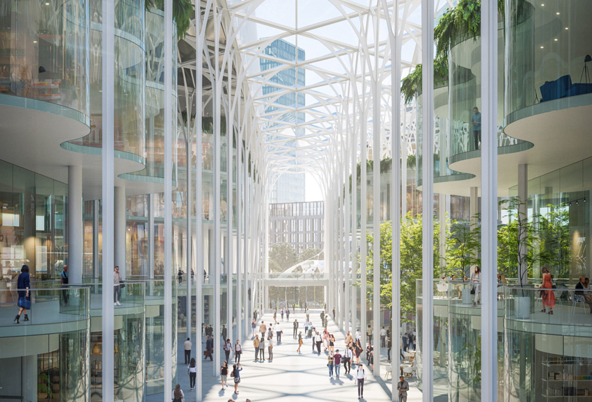 """A 500ft long galleria features a repetitive arboreal structure; slender columns form an 'avenue of trees', their detailed branch-like crowns connecting to support the glass canopy. This vaulting arcade creates a promenade of pavement cafes, shops and restaurants."""