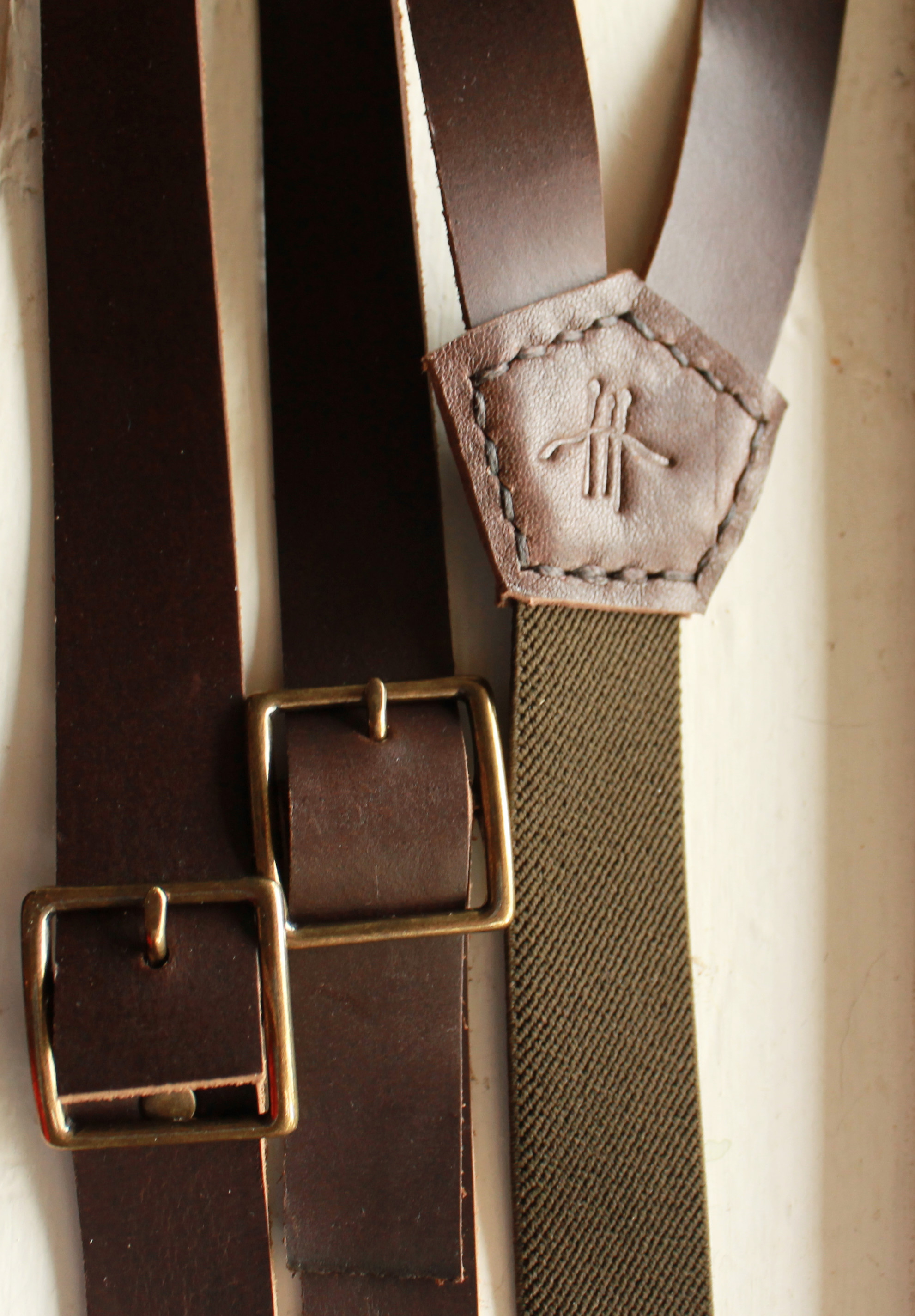 Here is most of the areas of work in a set of suspenders. I leave the straps unfinished in order to provide custom sizing.