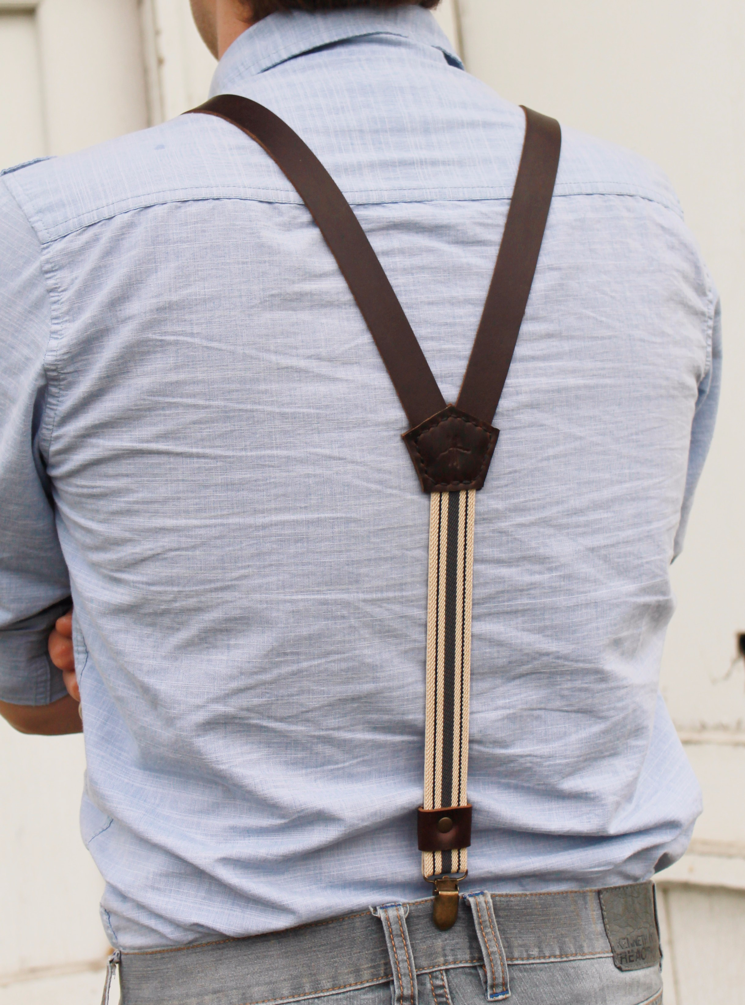 I don't want the yoke angle to be so severe that it causes the front straps to want to spread too much. It's also important to remember that some jeans and pants have the two belt loops in the back while others don't. I can only wear a three strap suspender with this type of jean.