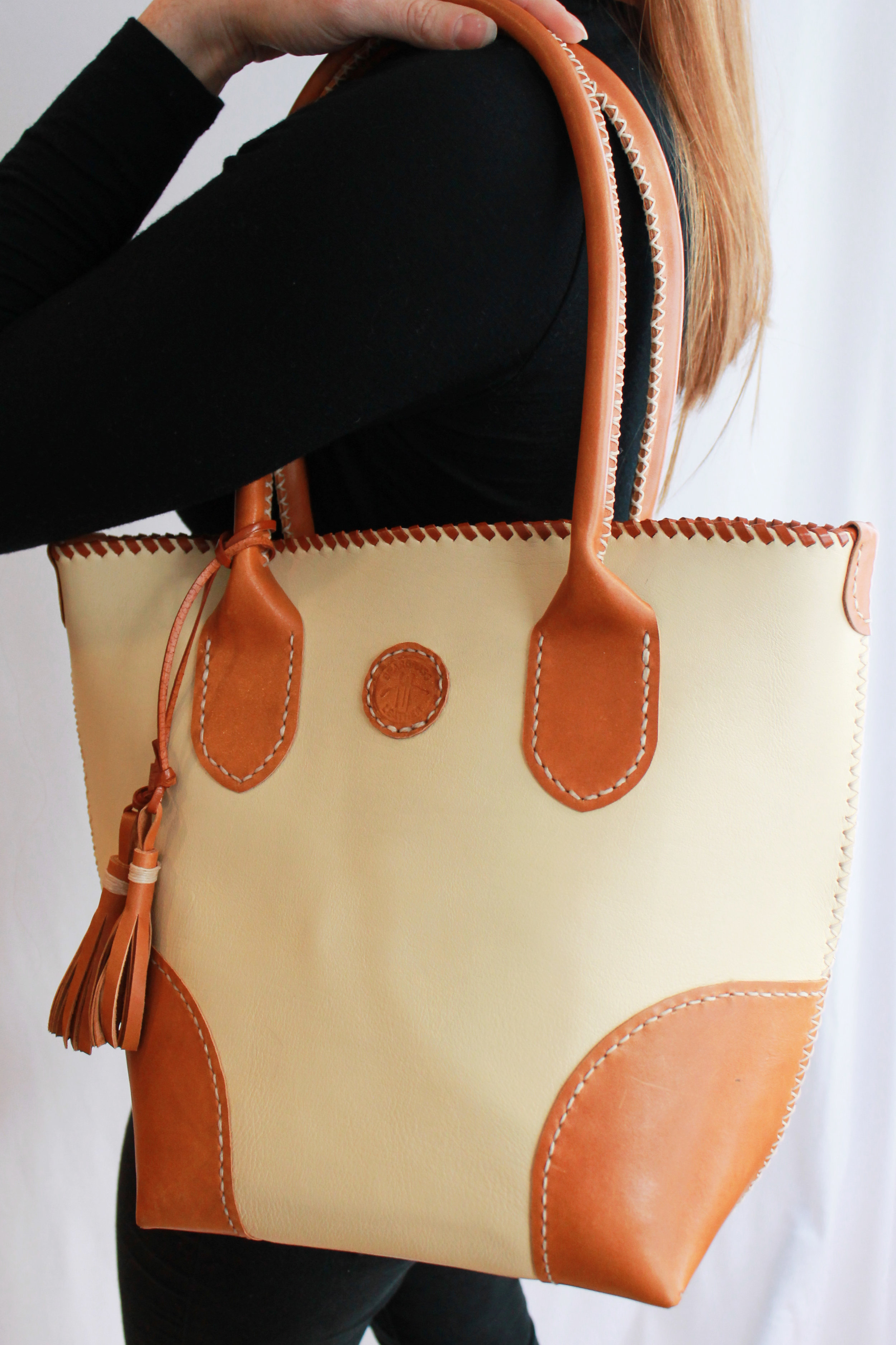 The Lakeside Rambler has amazing cream colored, soft full grain leather with firm caramel corners, strap, tassel, and lace.