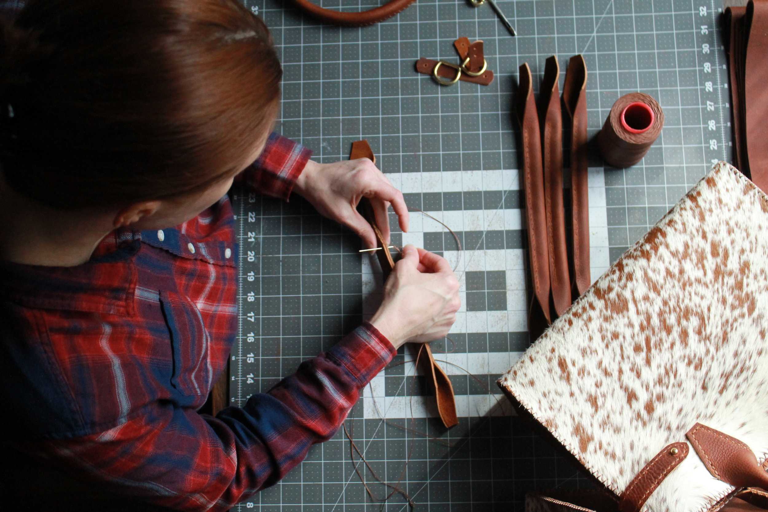 Leather workbench for handmade leather handbags in Montana