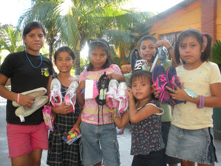 Children at Ciudad de Los Ninos orphanage receiving shoes, candies and other gifts.