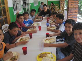 The boys eating lunch, can you find the gringo?