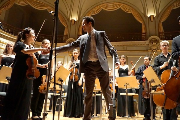 Philip Draganov conducts the Youth Classics Orchestra in the Tonhalle Zurich (Switzerland).