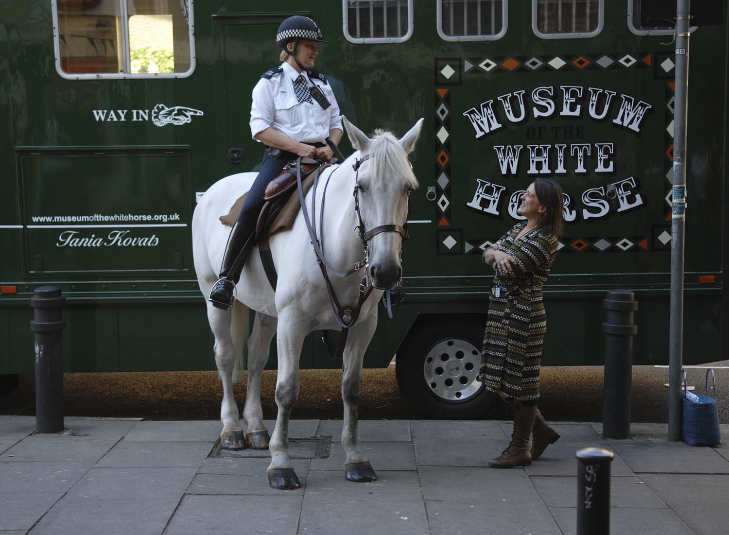 Tania Kovats and white police horse in front of The Museum of the White Horse
