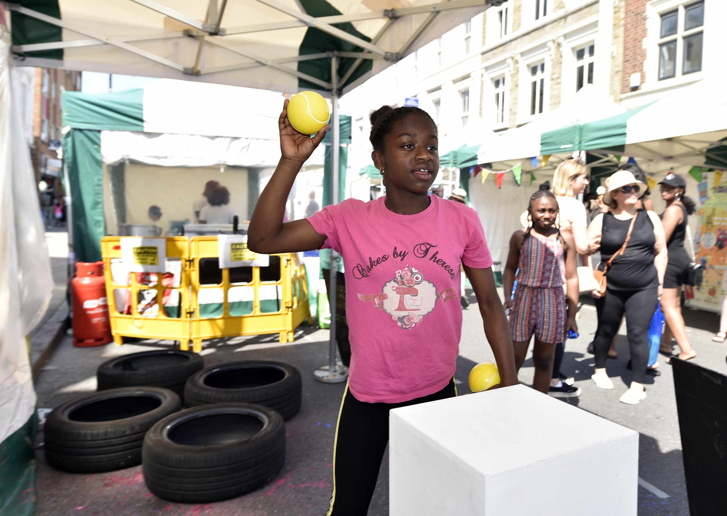 Young people taking part in PEER Ambassador Naile's obstacle course incorporating plinths usually used in an exhibition