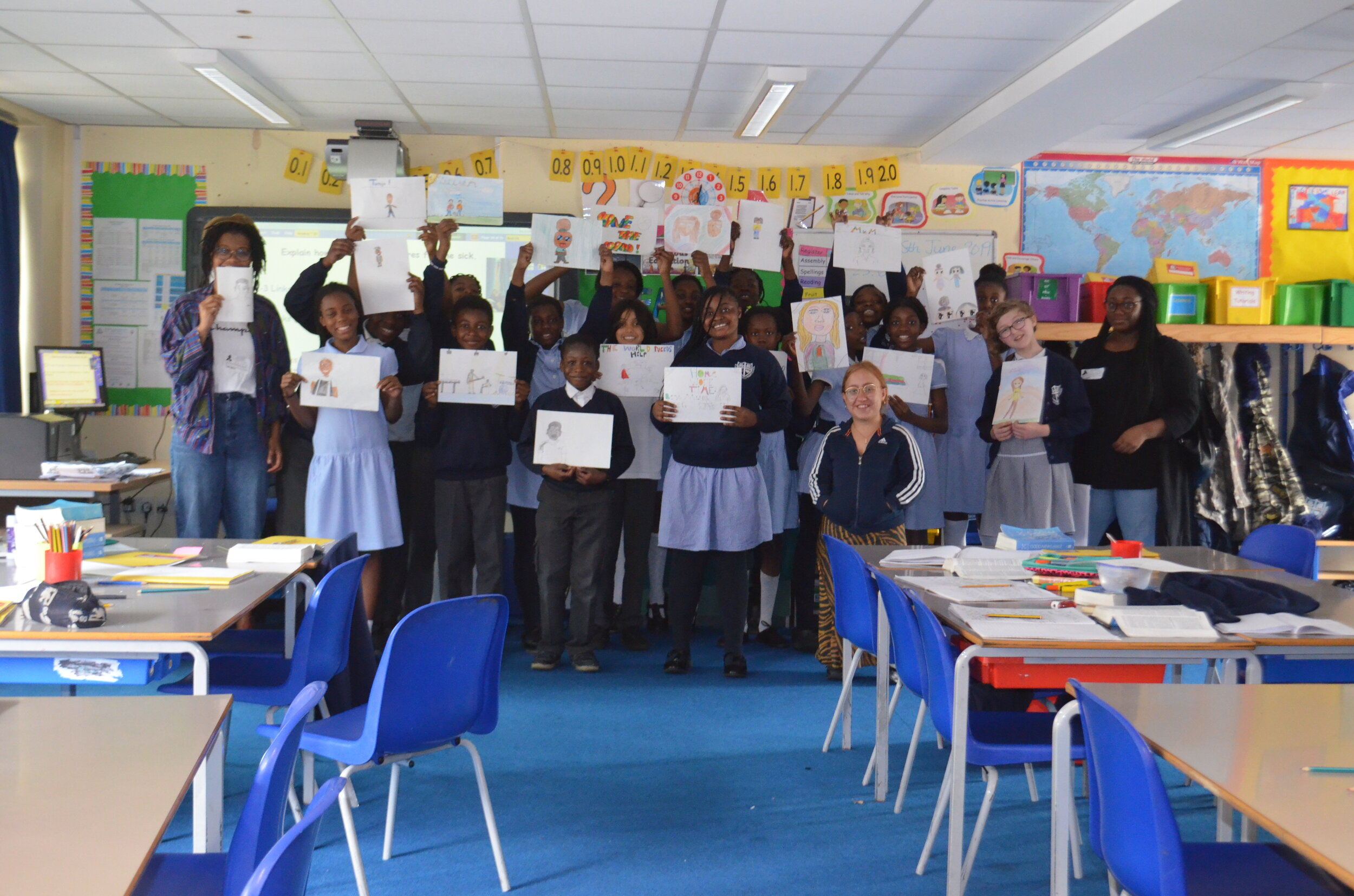Oliva, Cora and Devinya with Yr 6 pupils and their artworks