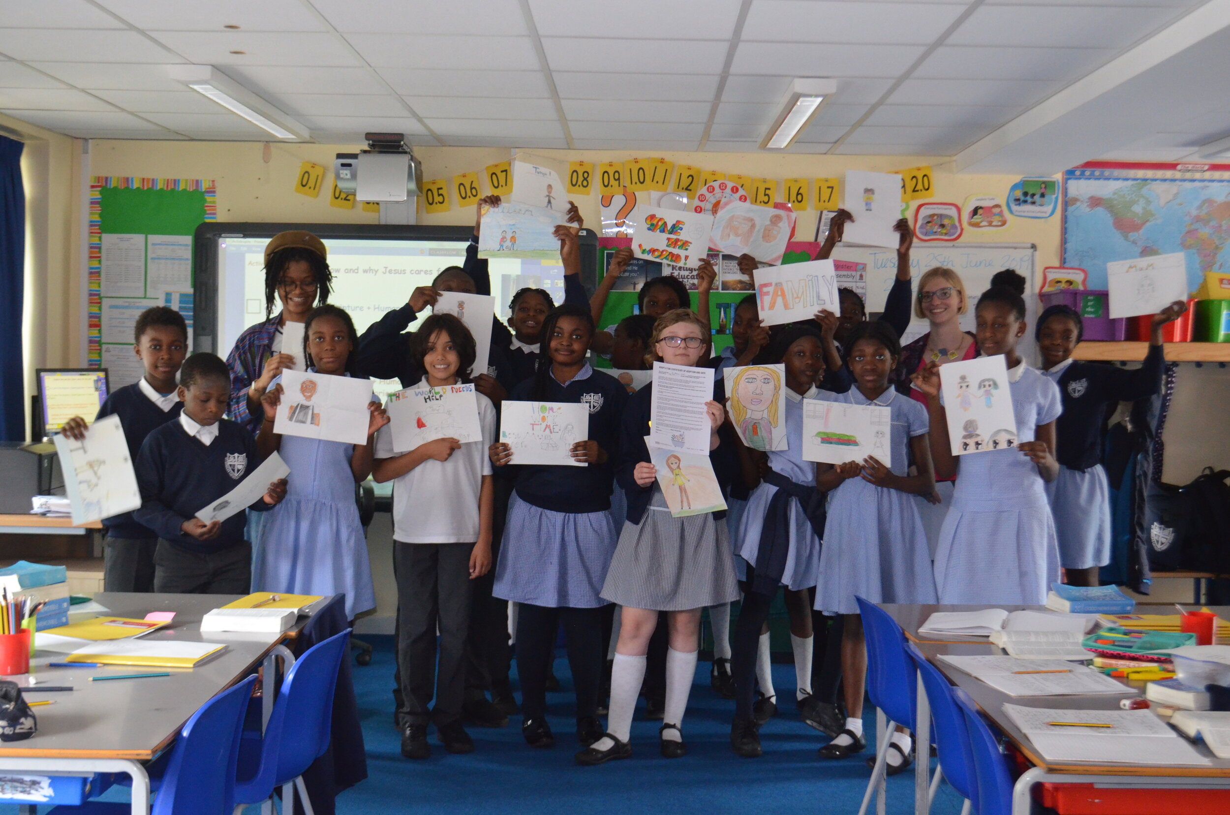 Olivia, Alice and Yr 6 pupils with their artworks and AAT Certificate