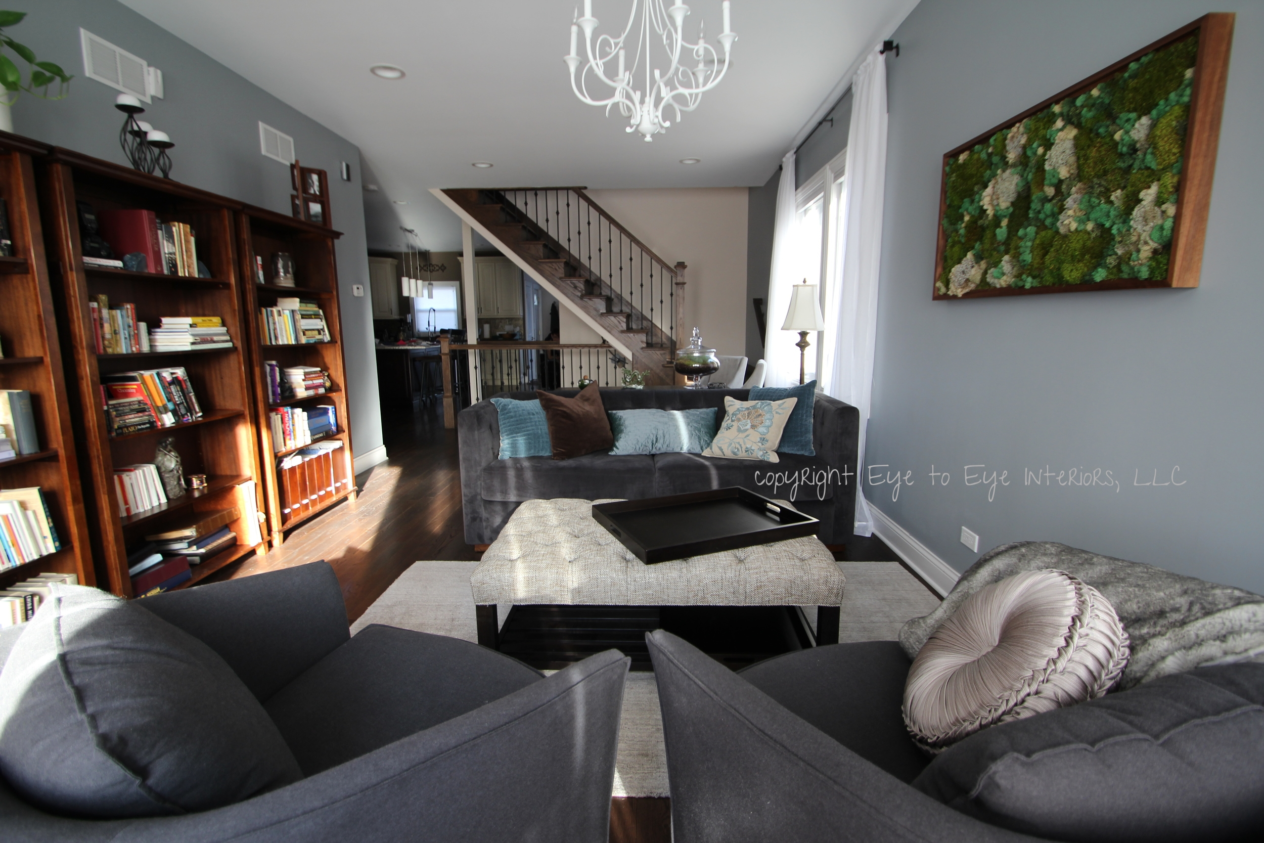 decorating, dark hardwood floors, moss painting, gray blue and brown accents, white chandelier
