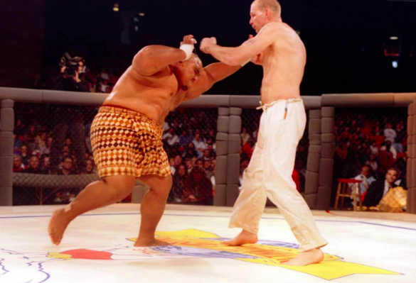 Sumo wrestler Teila Tuli took on martial artist Gerard Gordeau in the first-ever UFC bout on Nov. 12, 1993. (Getty Images)
