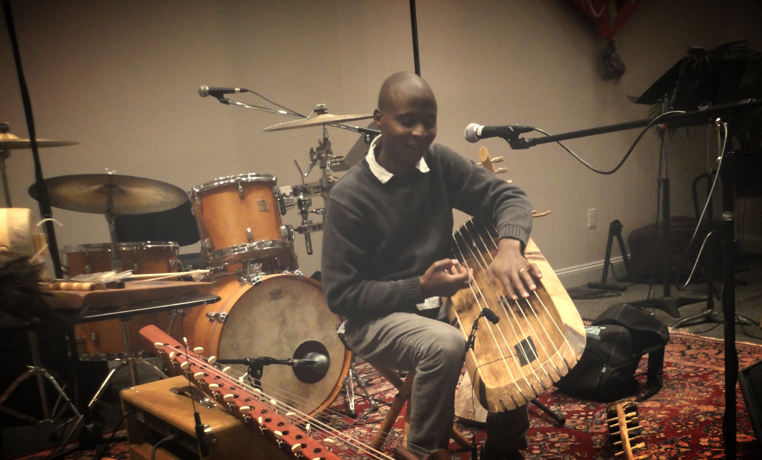 Gideon Ampere is a master musician and instrument maker from Uganda, East Africa.Gideon shares the music and dance of his homeland with any and all who will listen, appreciate, and participate. He has experience performing on several Ugandan folk instruments including zithers, bow harps, tube fiddles, lyres, flutes, thumb pianos, panpipes, log xylophones and drums.Gideon has participated in workshops and artists gathering over many years as part of the CT Cultural Heritage Arts Program.He has a Master of Arts in ethnomusicology from Wesleyan University and a Bachelors of Arts from the University of Connecticut.