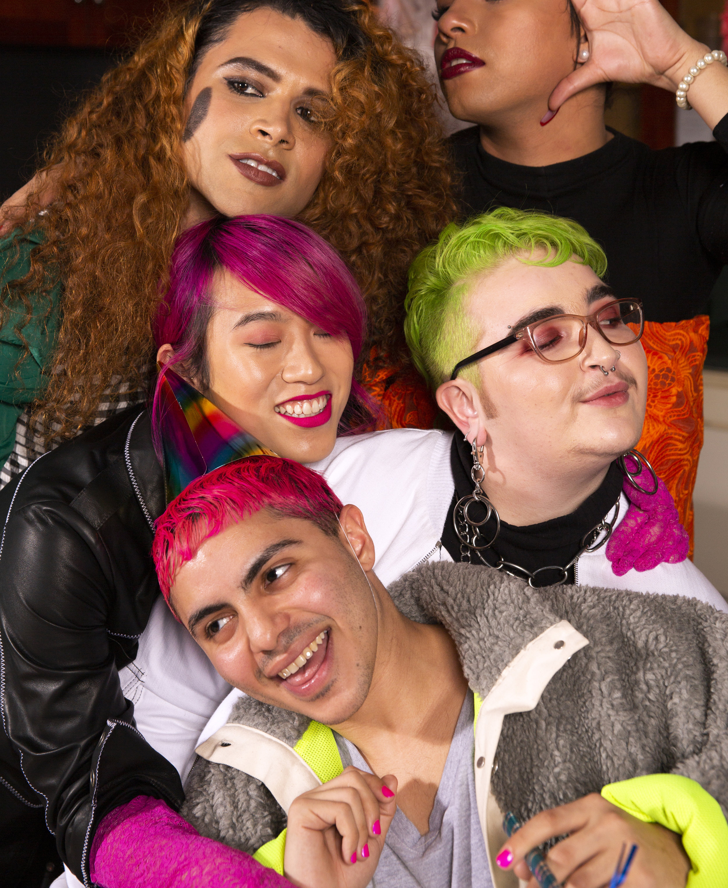 A group of friends of varying genders taking a photo at a party having a party.jpg
