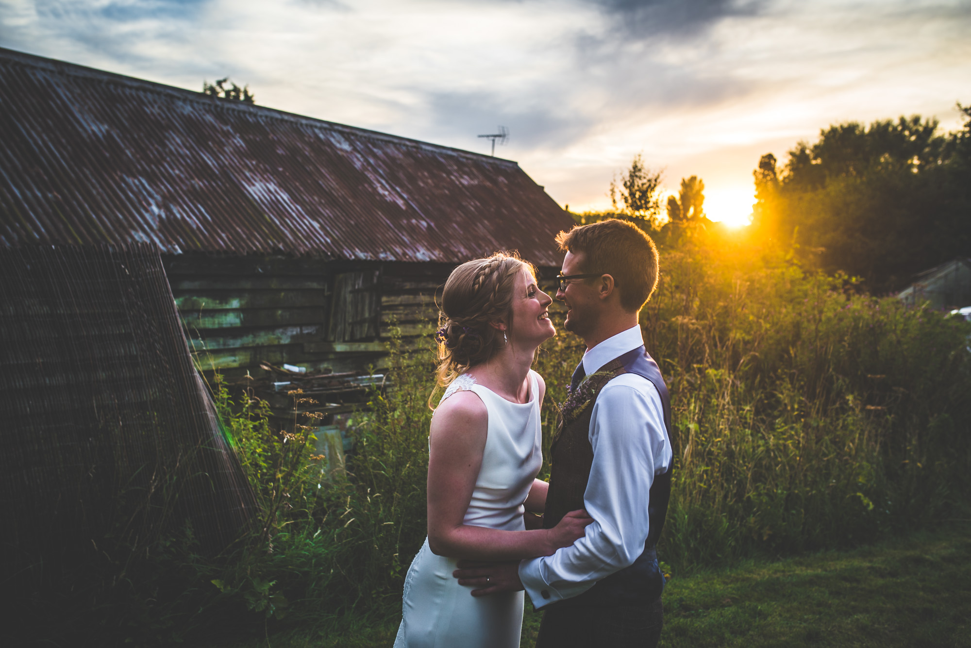 candid-sunset-cheltenham-wedding-couple