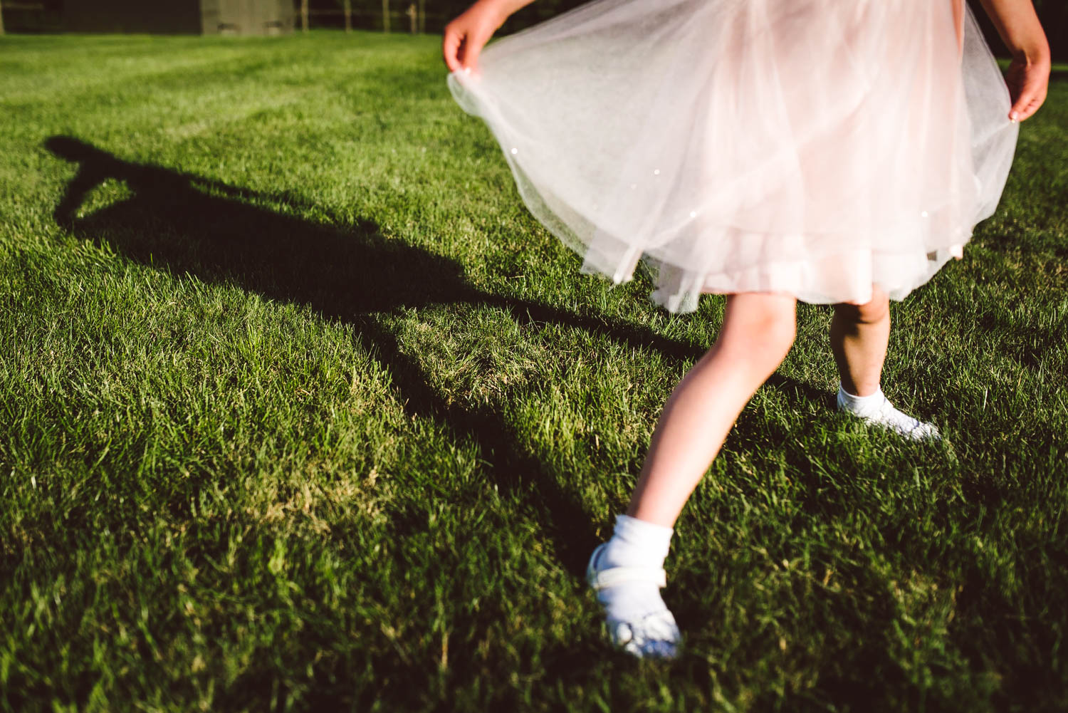 Bridesmaid plays with her shadow at this cool garden wedding