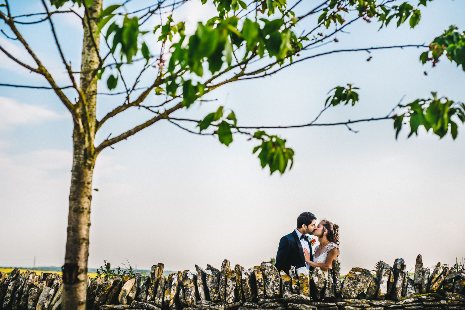 couple kissing behind the wall