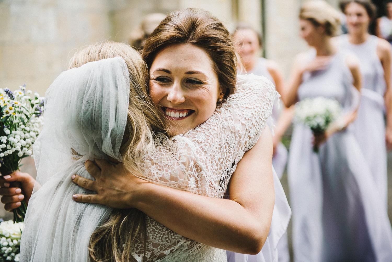 bridesmaid-hugs-bride.jpg